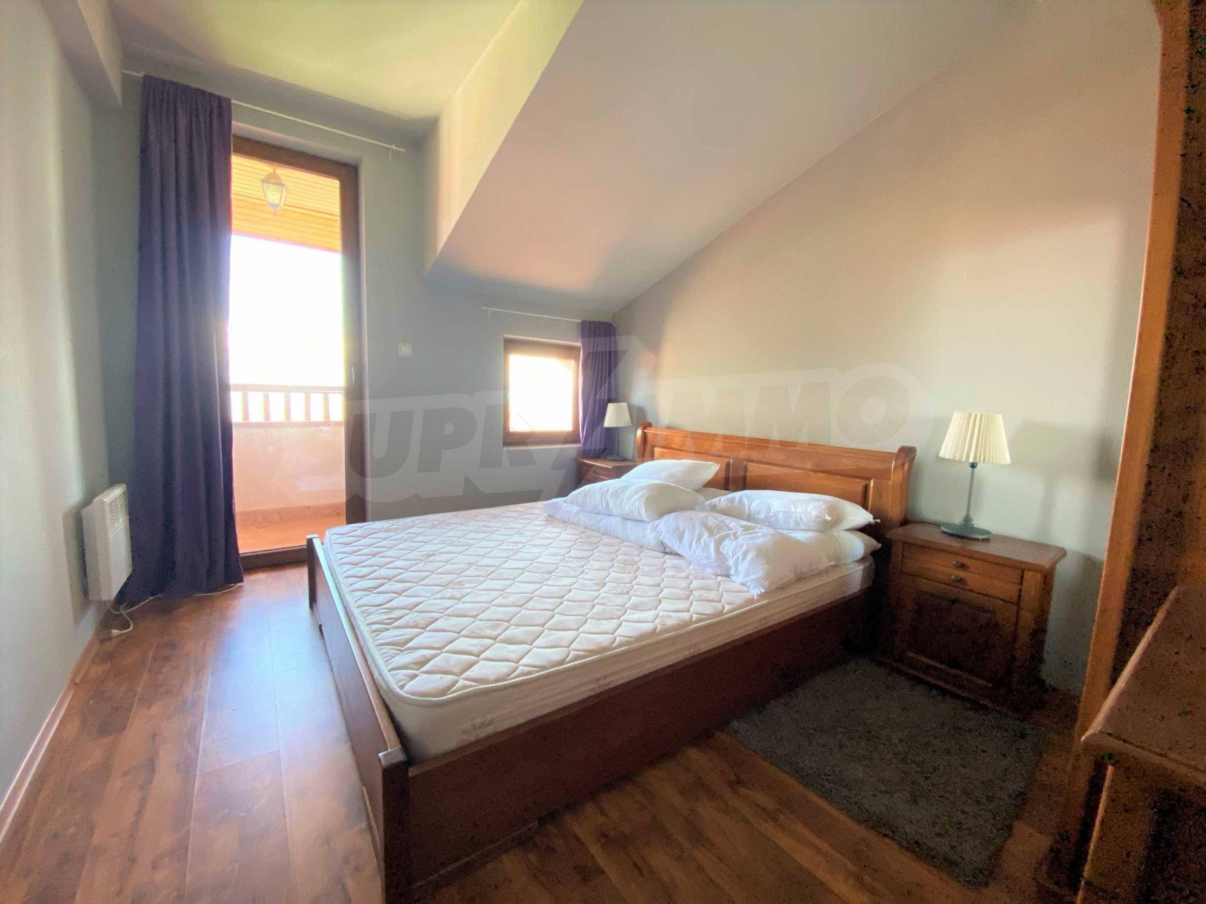 Апартамент с три спални с уникална панорамна гледка към Пирин планина в луксозен комплекс 12