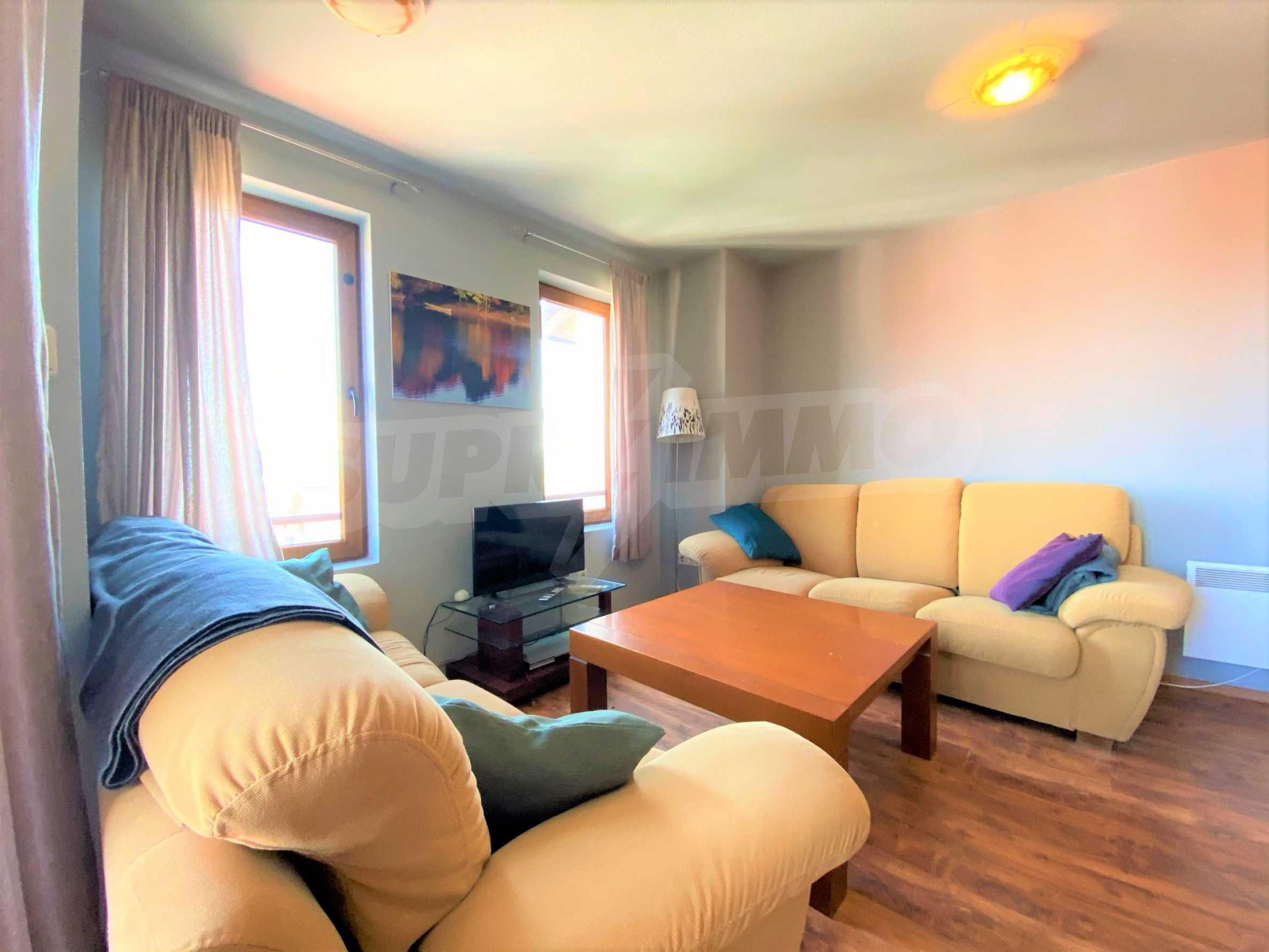 Апартамент с три спални с уникална панорамна гледка към Пирин планина в луксозен комплекс 1