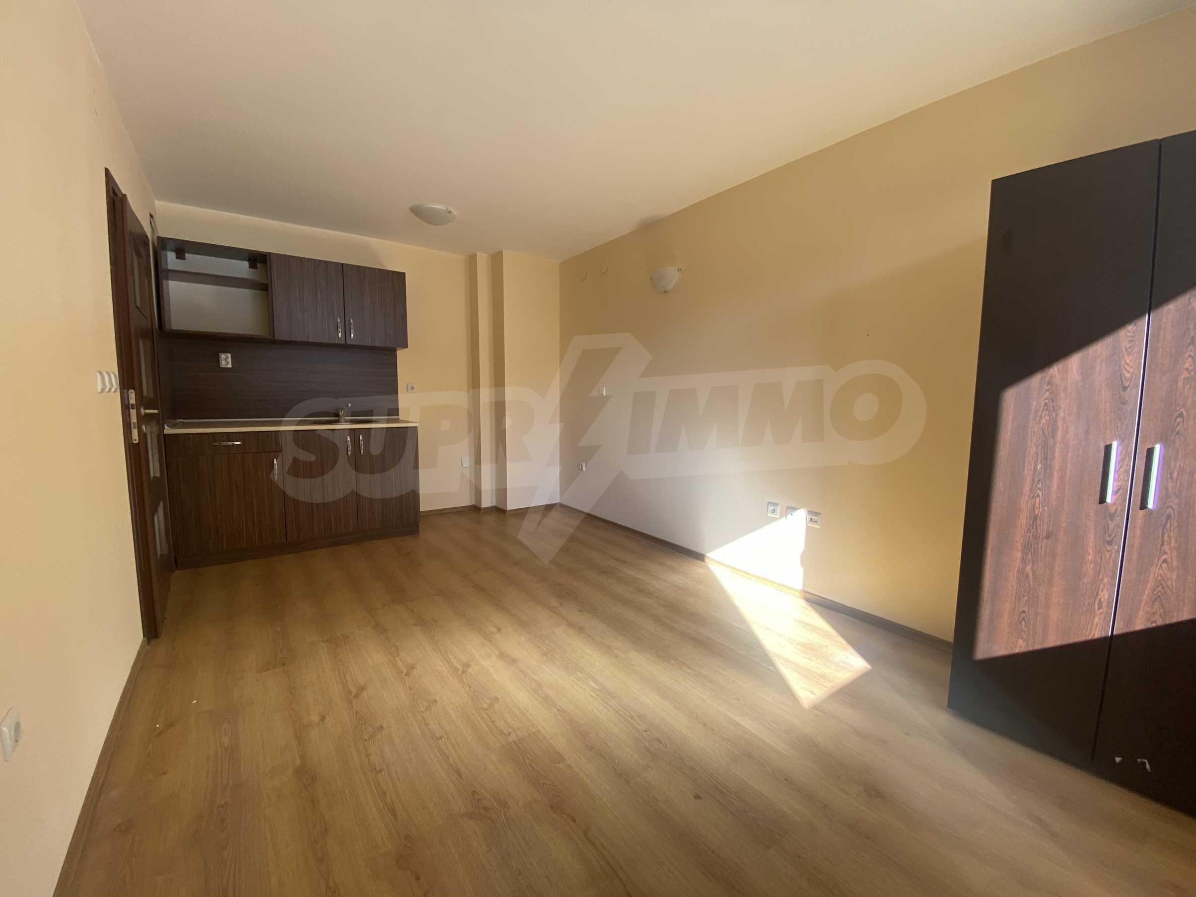 Необзаведен двустаен апартамент за продажба в СПА комплекс в Банско 1