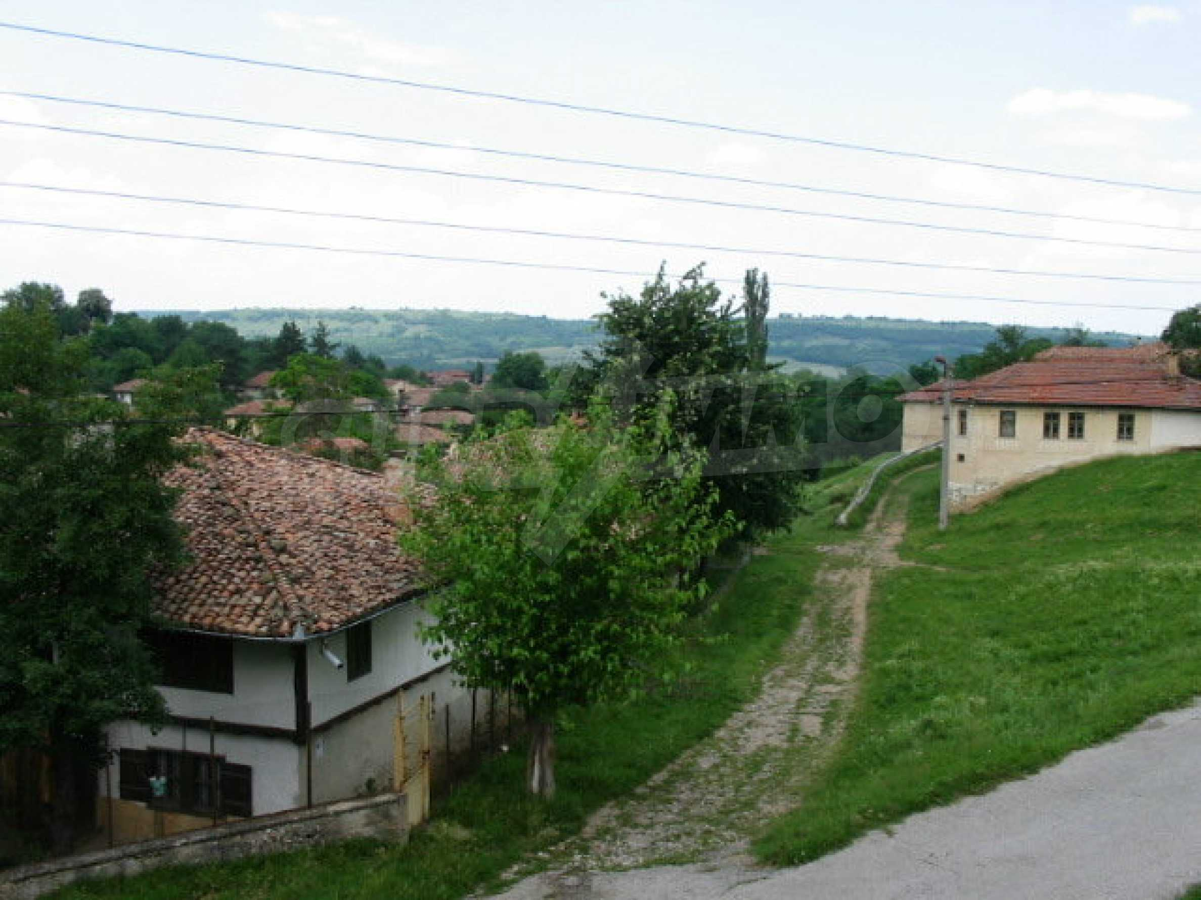 Two-storey traditional house for renovation in Mindya village  11