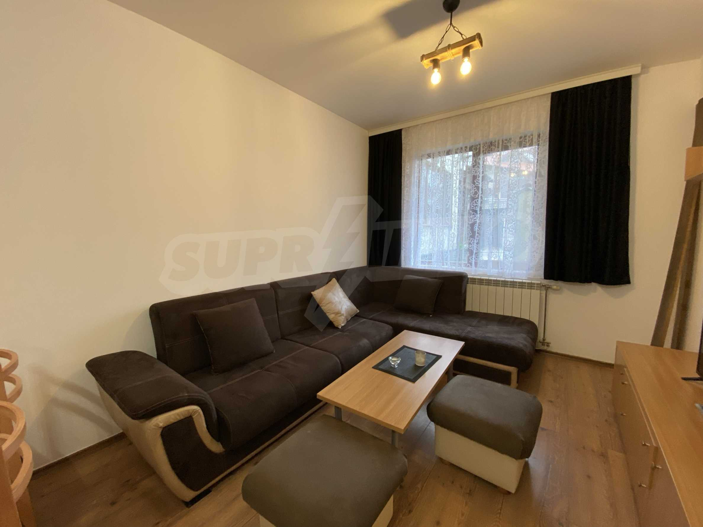 Two-bedroom apartment in a well-maintained building in Bansko 10
