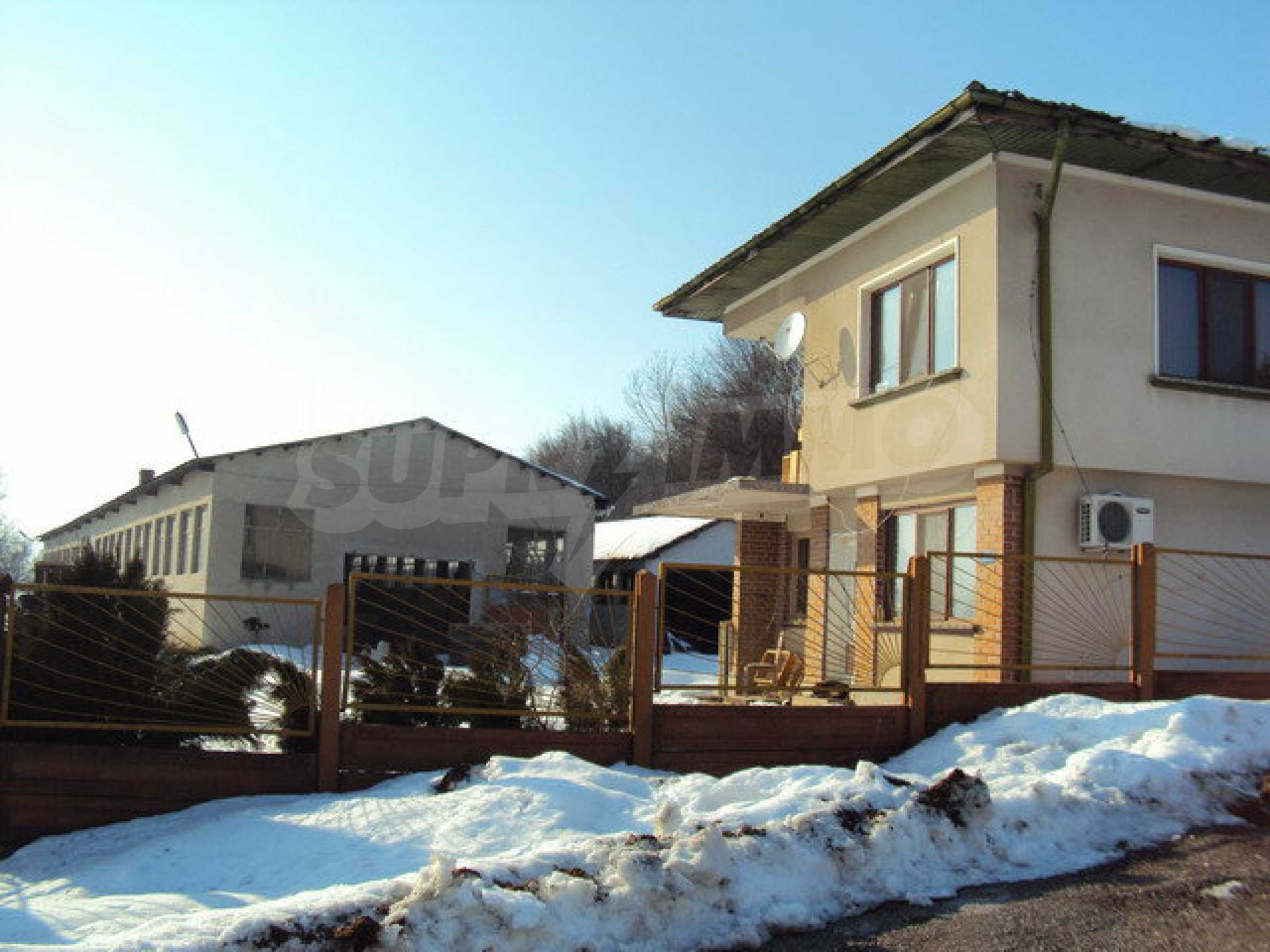 Two-storey house and a wood processing factory located in a village near Lovech
