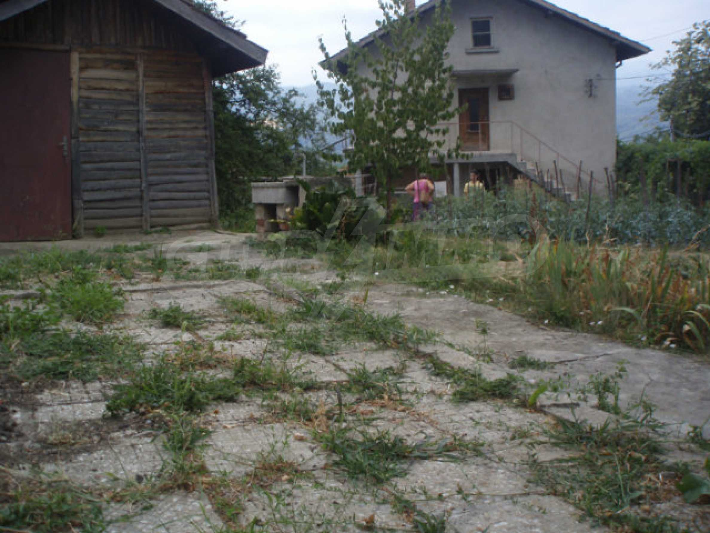 A nice plot of land with a small house in a very popular village 3