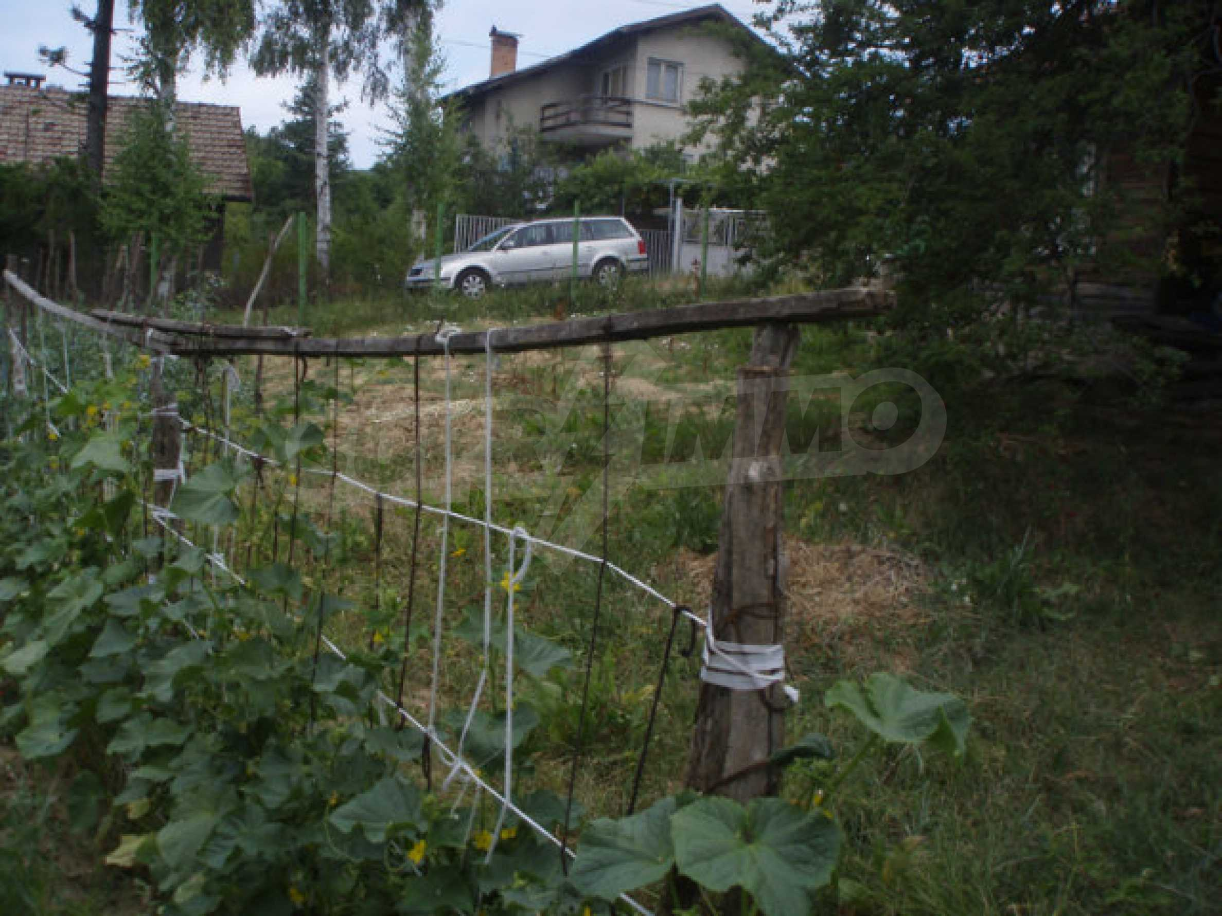 A nice plot of land with a small house in a very popular village 4