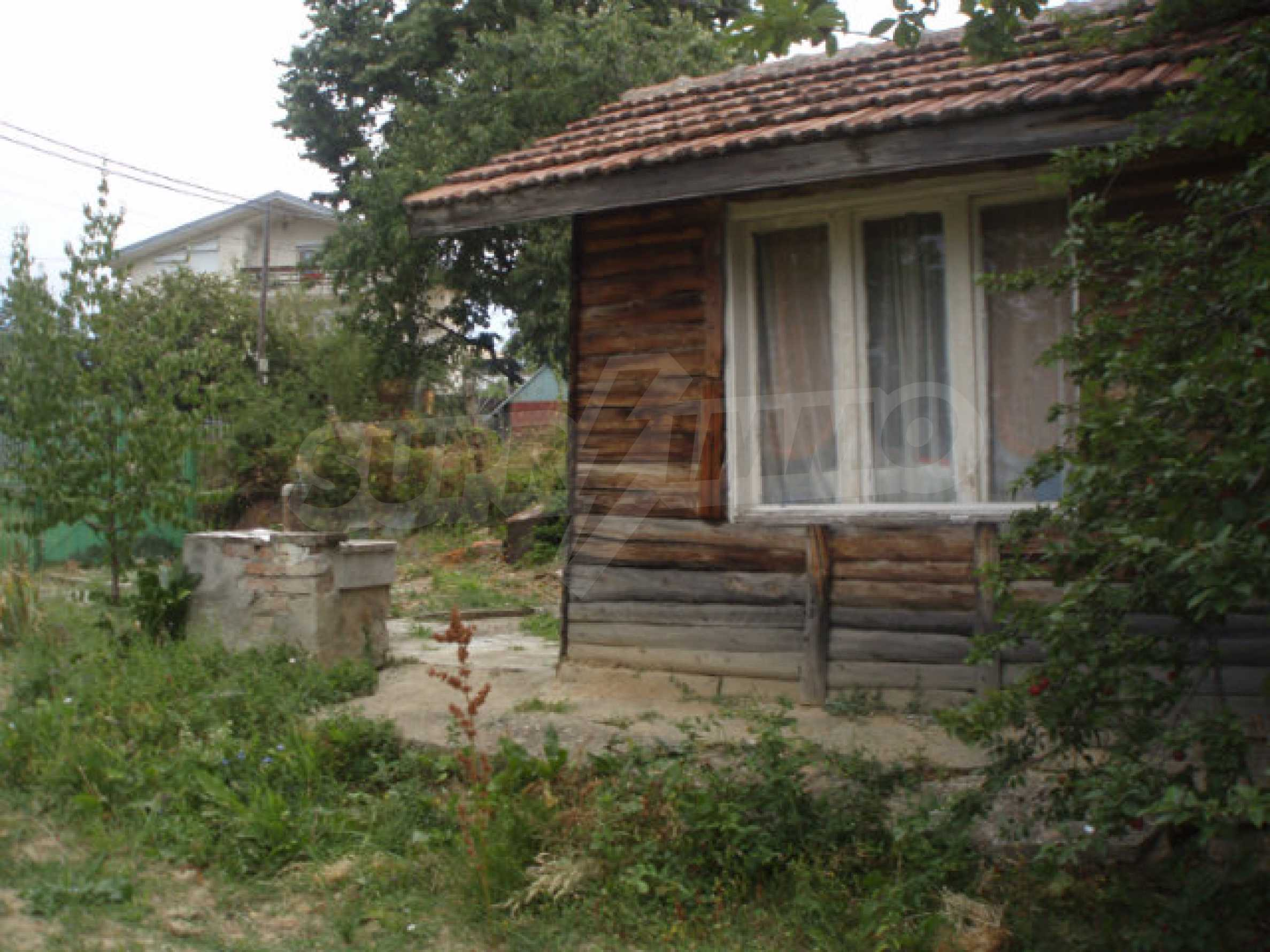 A nice plot of land with a small house in a very popular village 5