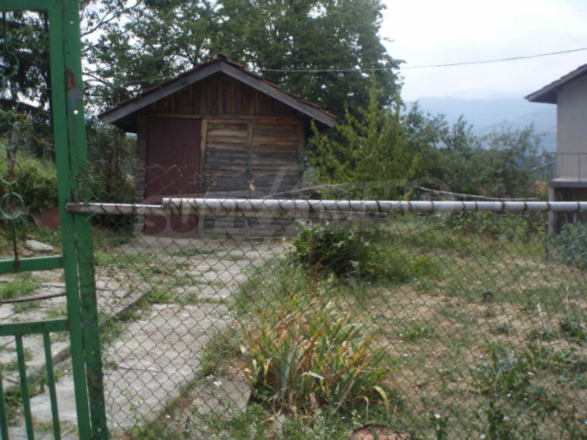 A nice plot of land with a small house in a very popular village 6