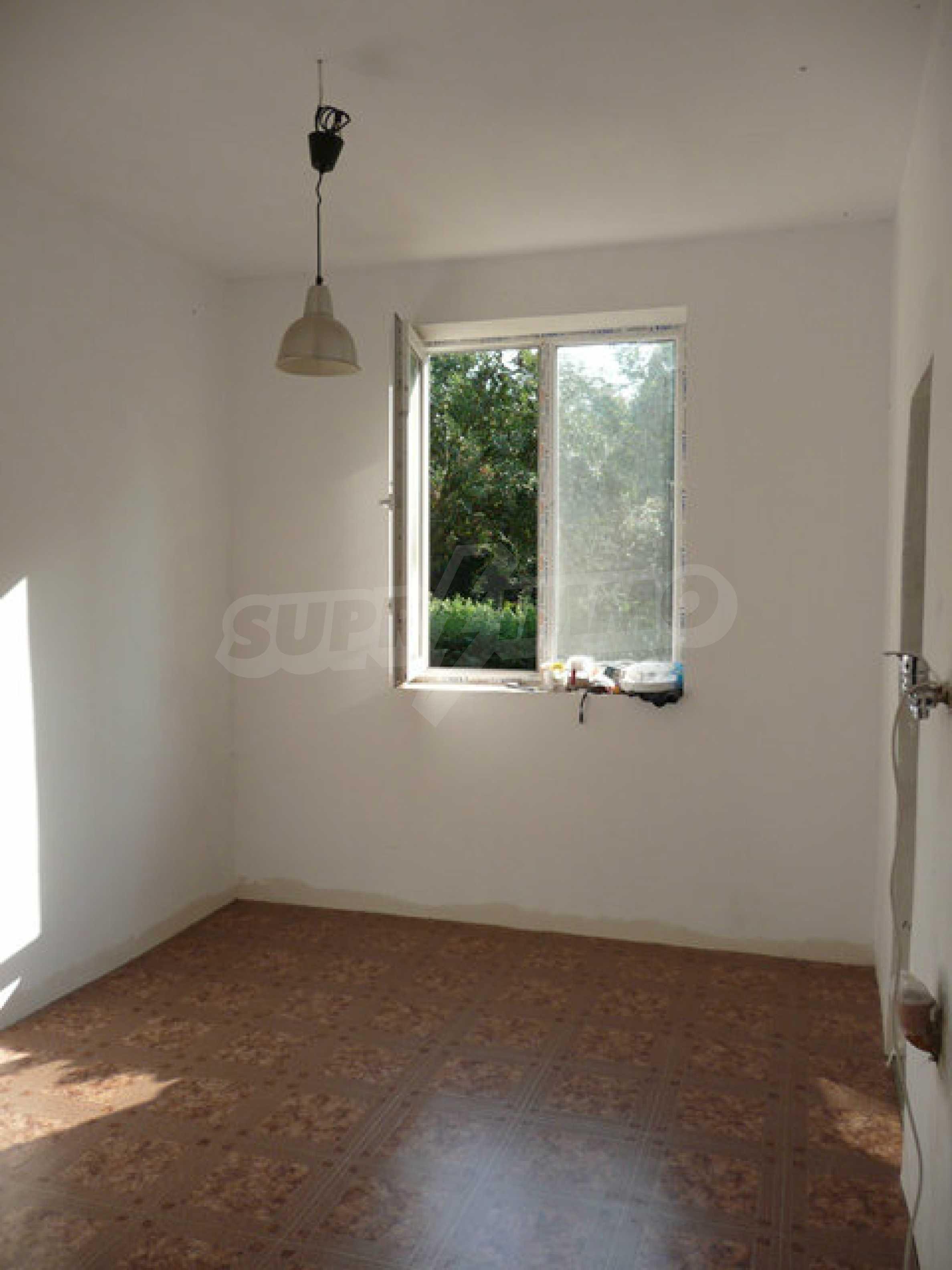 Ein-Zimmer-Wohnung im Dorf Strazhitsa 8