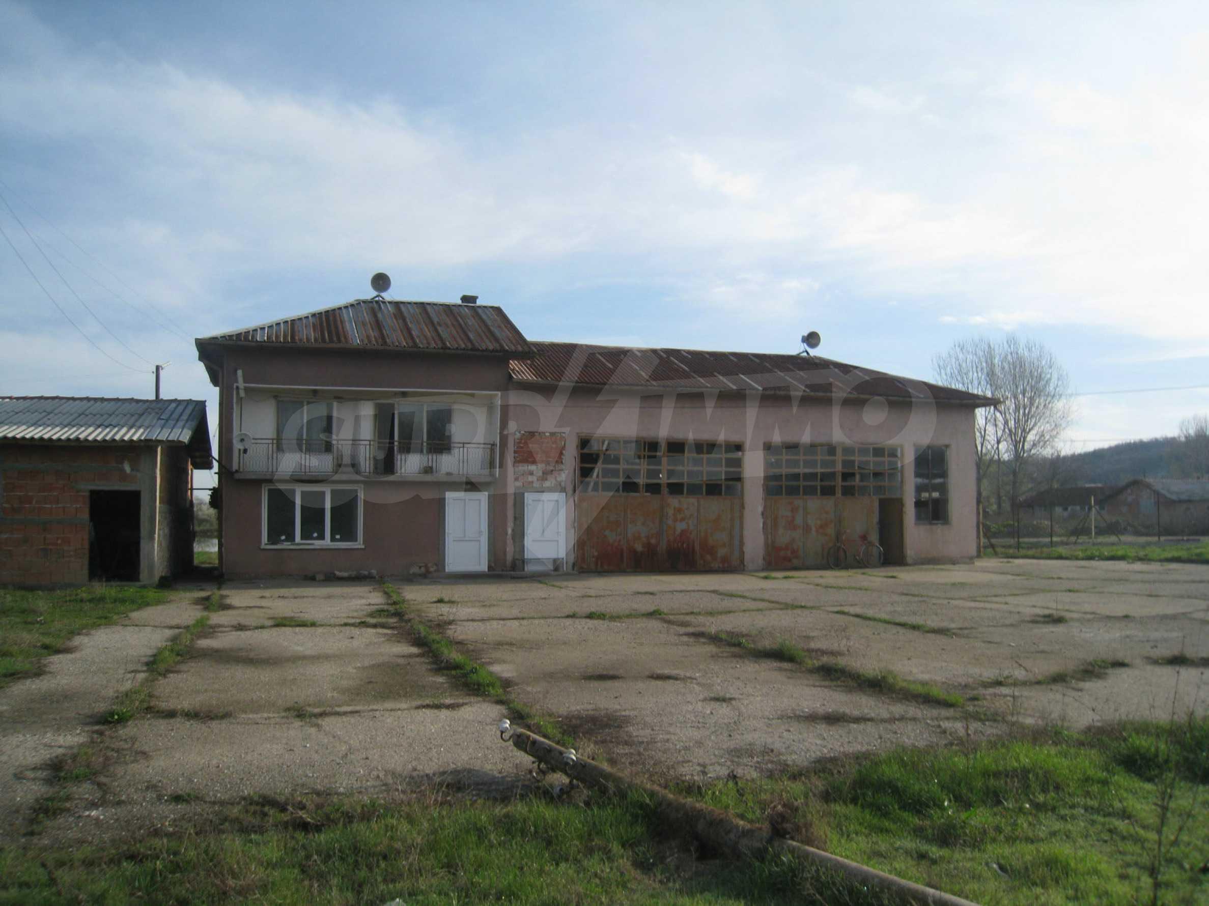 Fishpond, warehouses, residential areas and asphalt ground near Montana 10