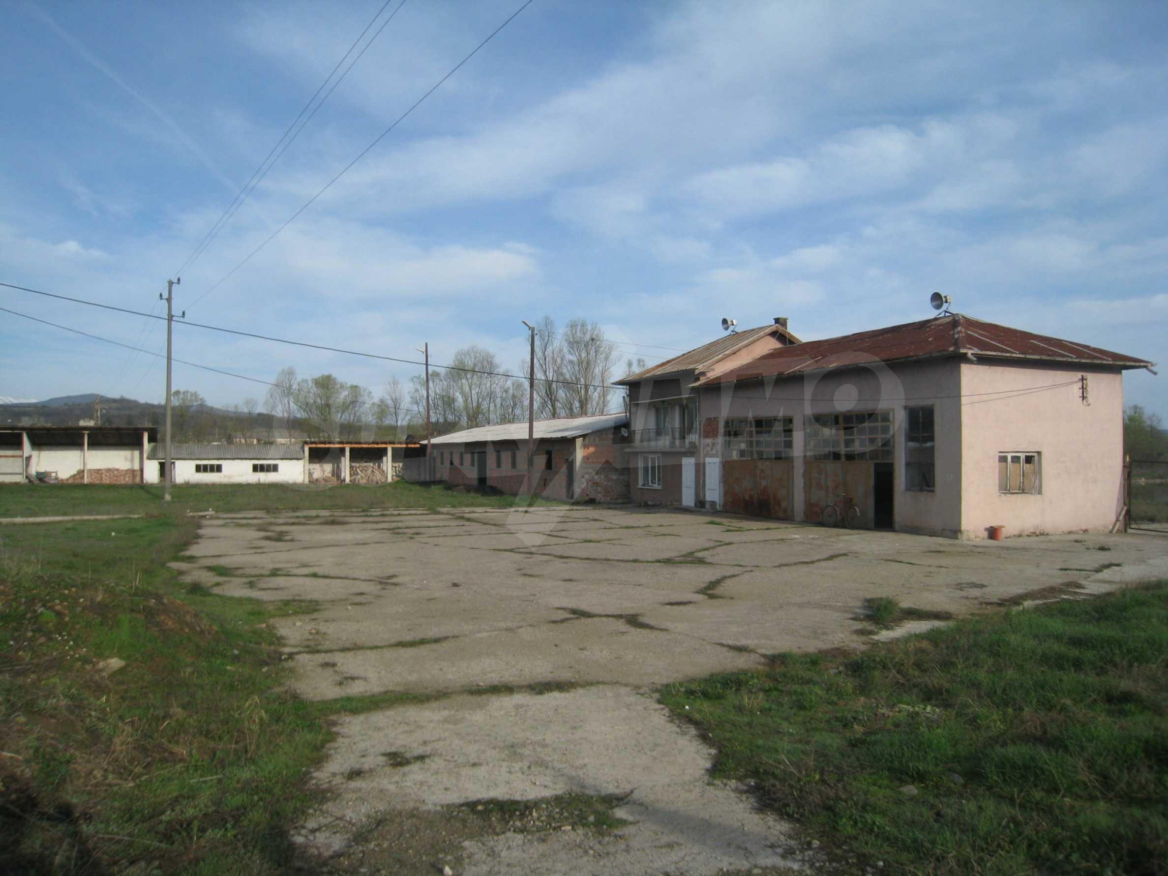 Fishpond, warehouses, residential areas and asphalt ground near Montana 16