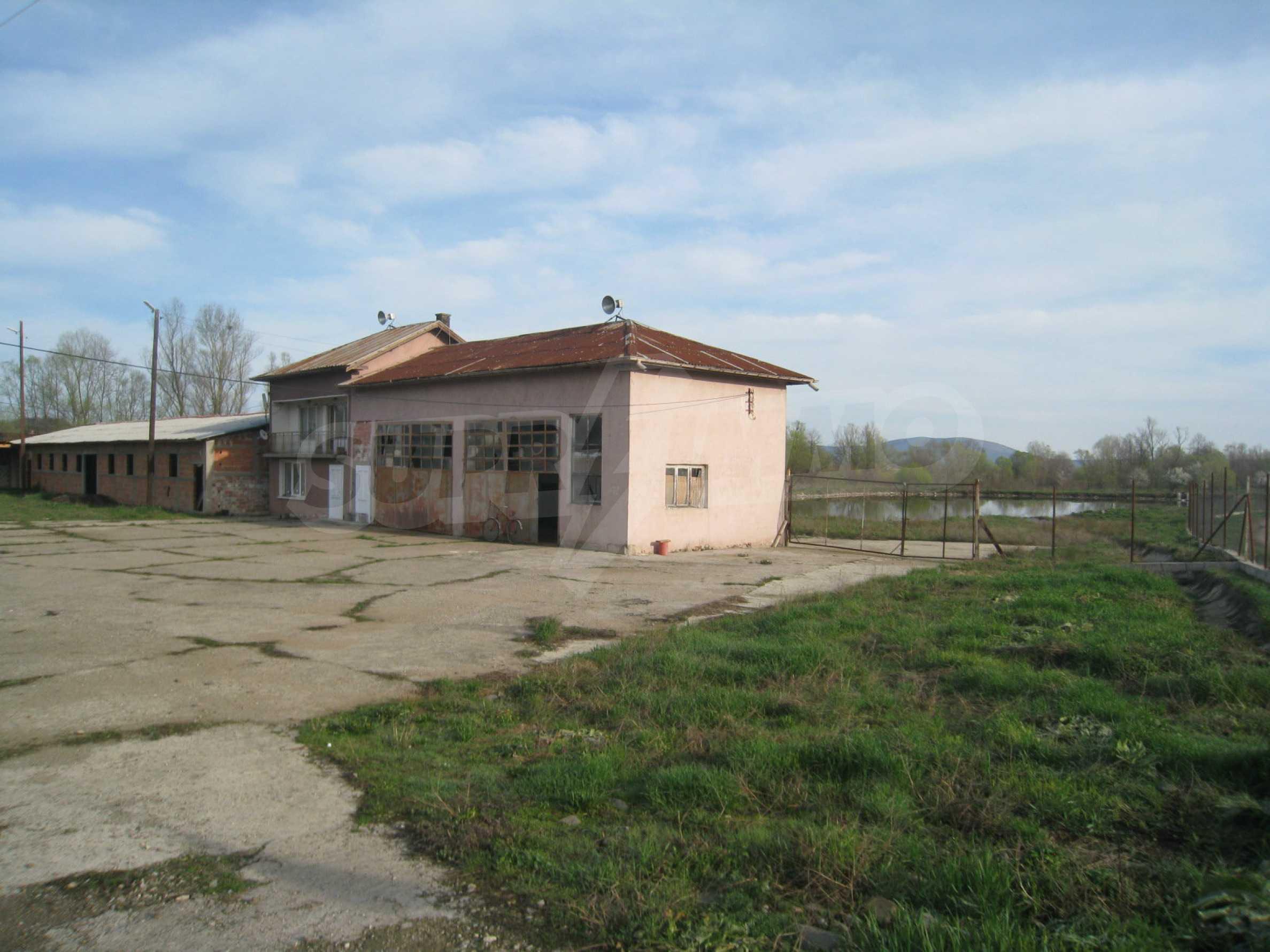 Fishpond, warehouses, residential areas and asphalt ground near Montana 17