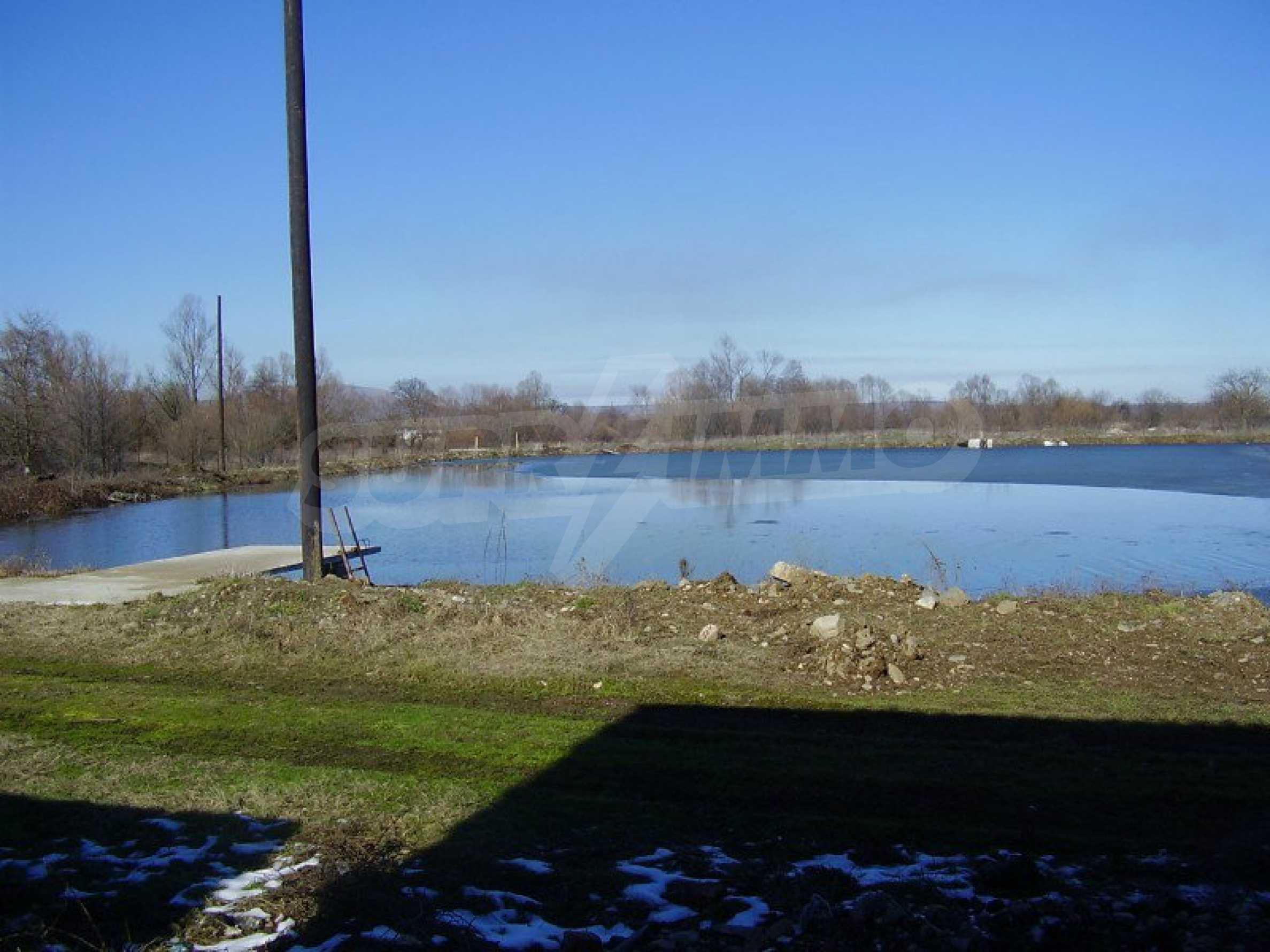 Fishpond, warehouses, residential areas and asphalt ground near Montana 19