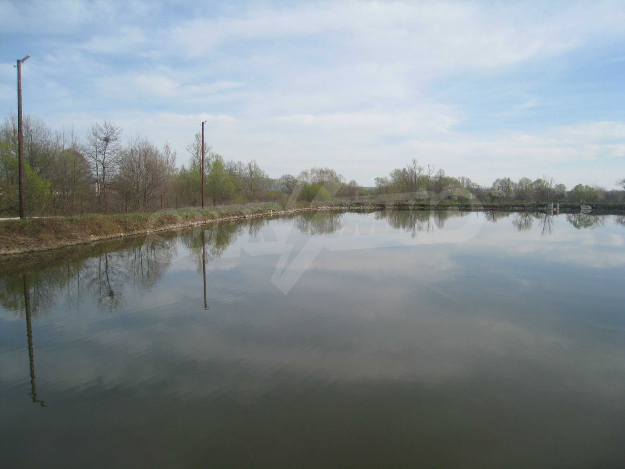 Fishpond, warehouses, residential areas and asphalt ground near Montana 23