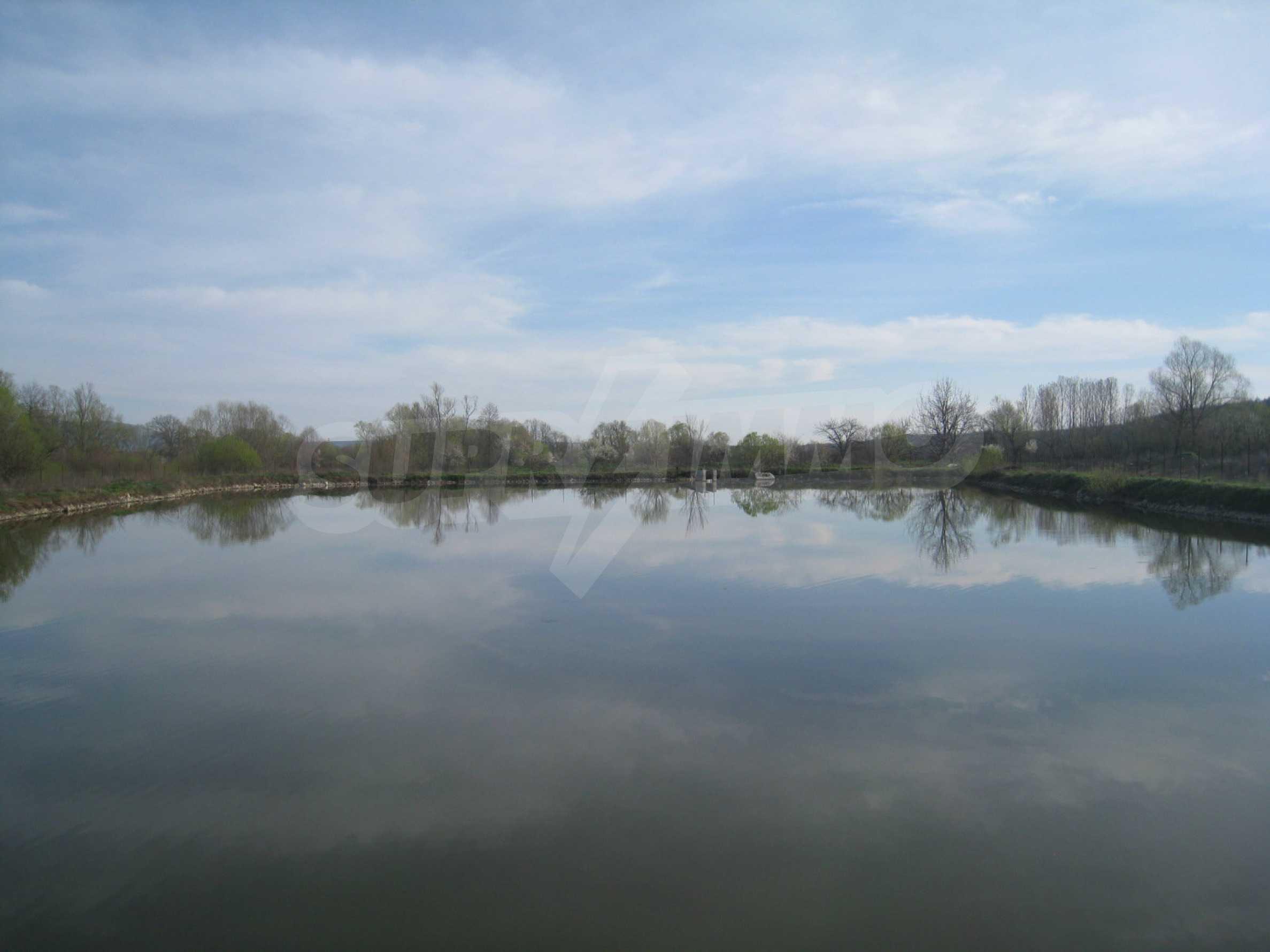 Fishpond, warehouses, residential areas and asphalt ground near Montana 24