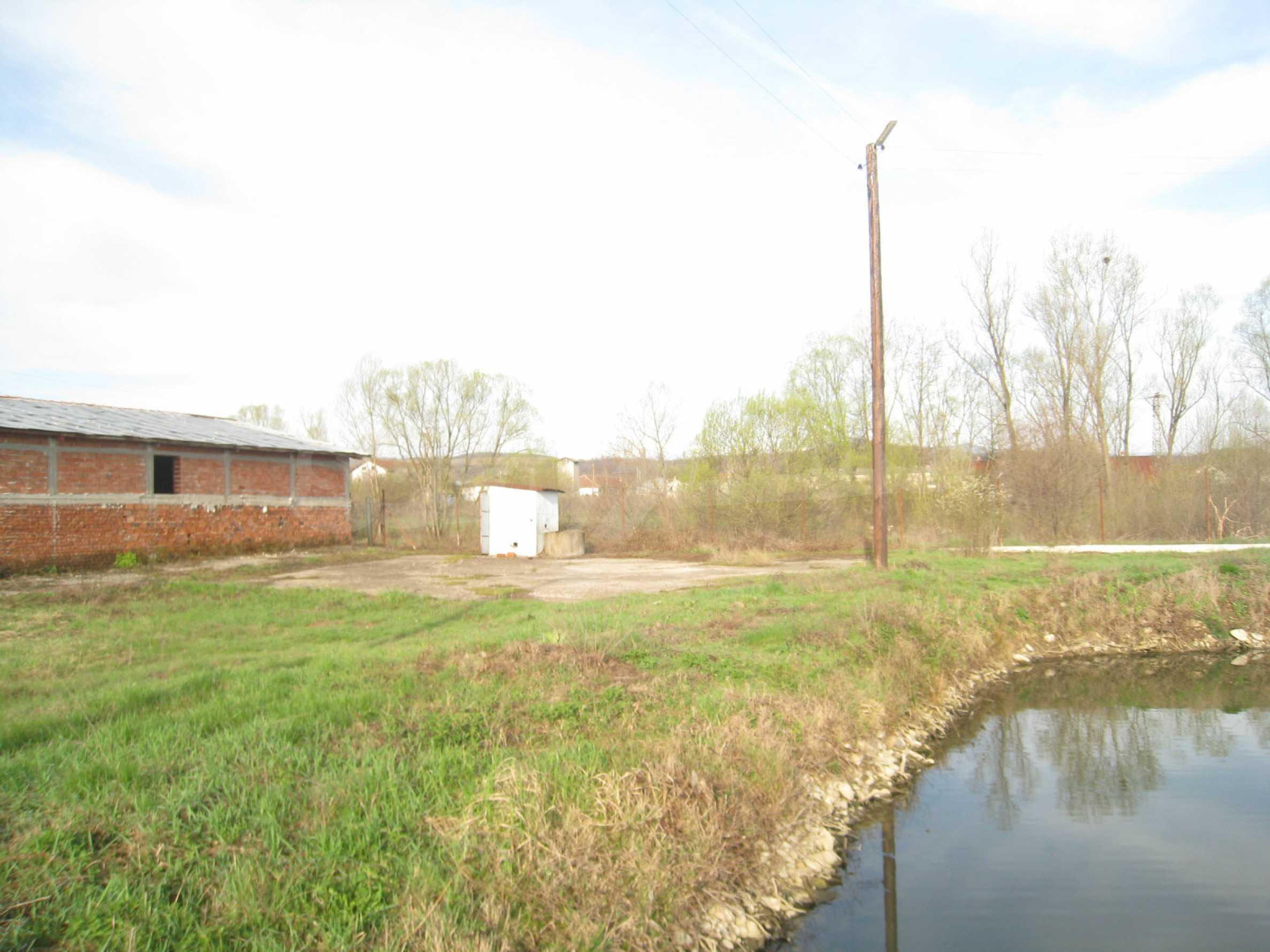 Fishpond, warehouses, residential areas and asphalt ground near Montana 25