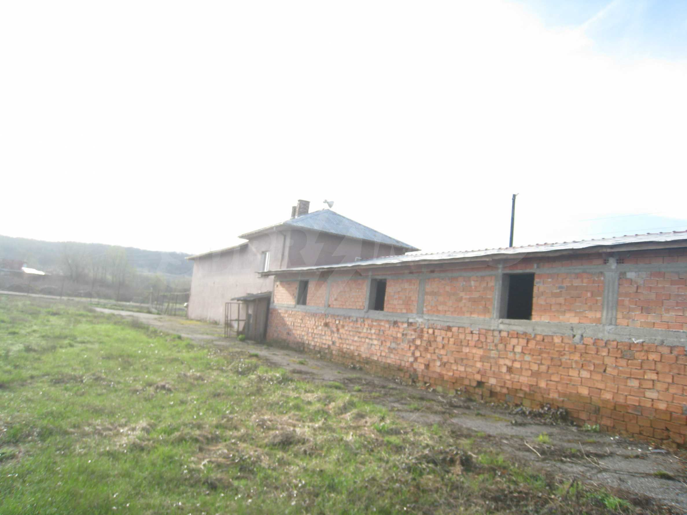 Fishpond, warehouses, residential areas and asphalt ground near Montana 28