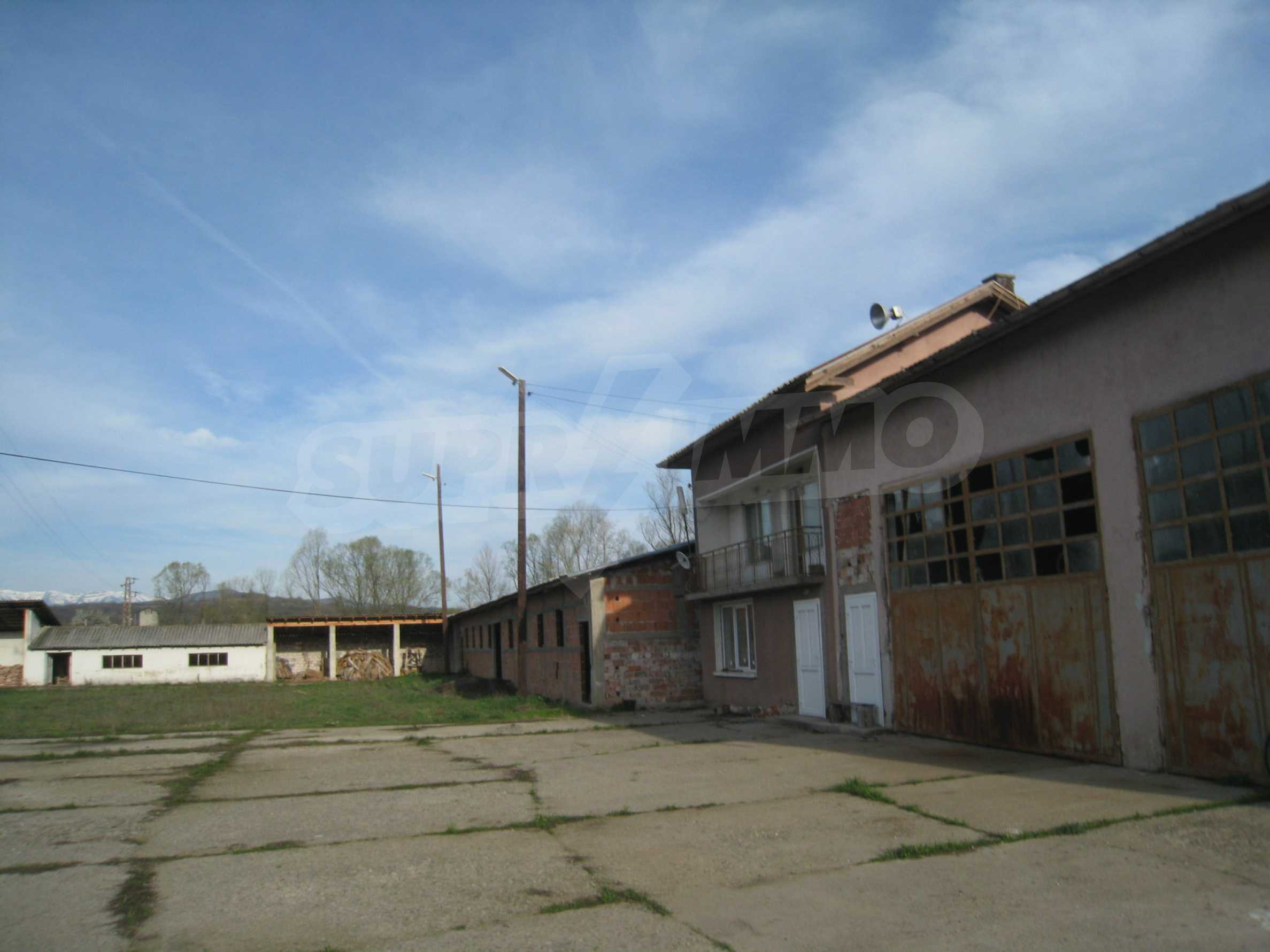 Fishpond, warehouses, residential areas and asphalt ground near Montana 2