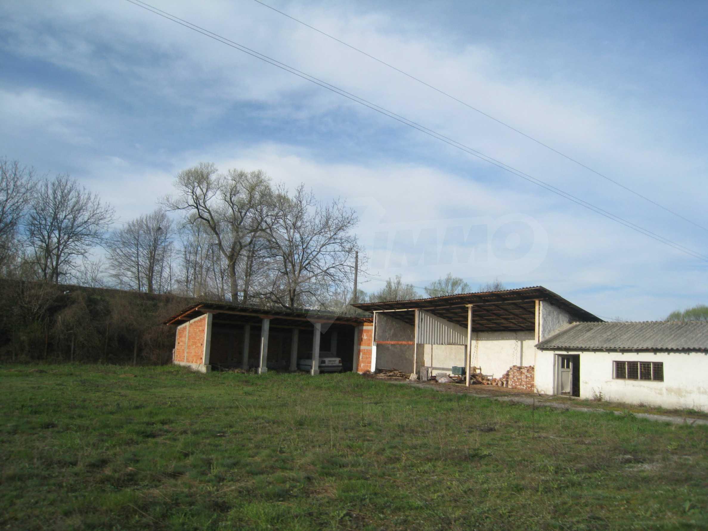 Fishpond, warehouses, residential areas and asphalt ground near Montana 31