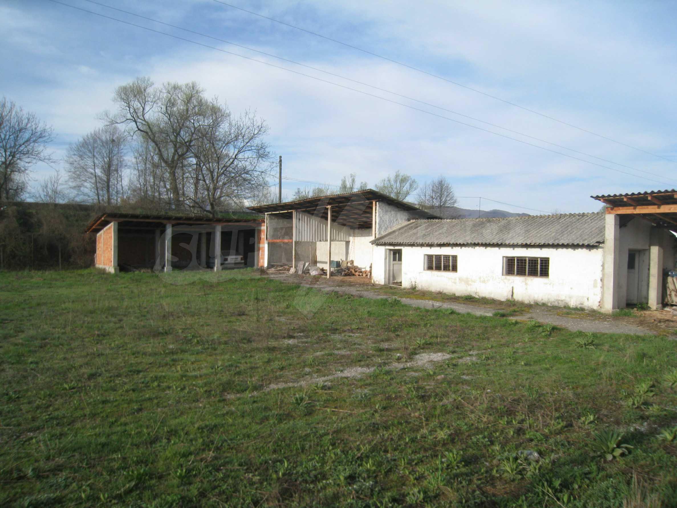 Fishpond, warehouses, residential areas and asphalt ground near Montana 32