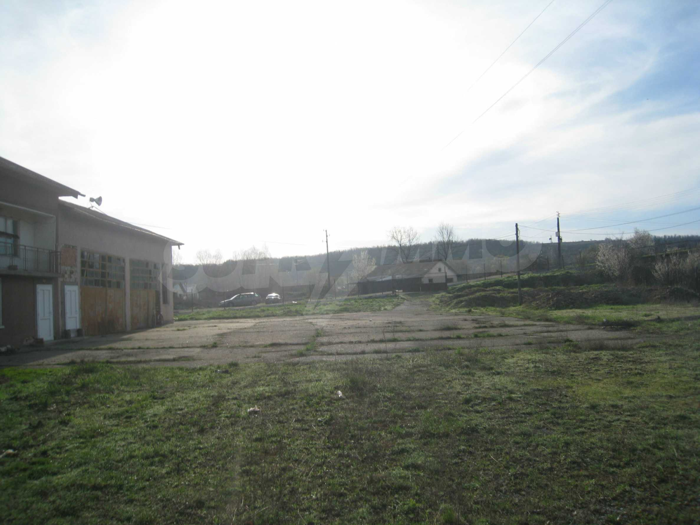 Fishpond, warehouses, residential areas and asphalt ground near Montana 33