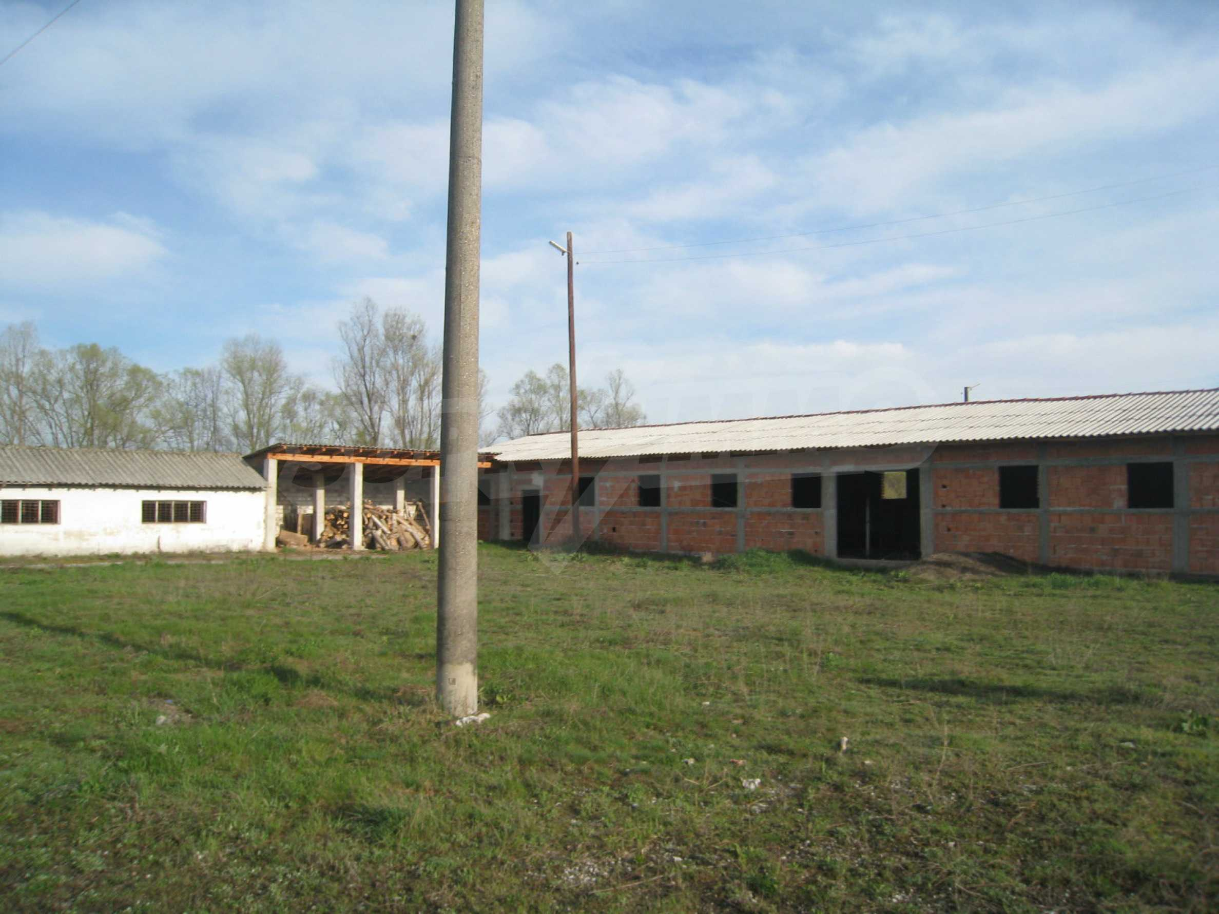 Fishpond, warehouses, residential areas and asphalt ground near Montana 35