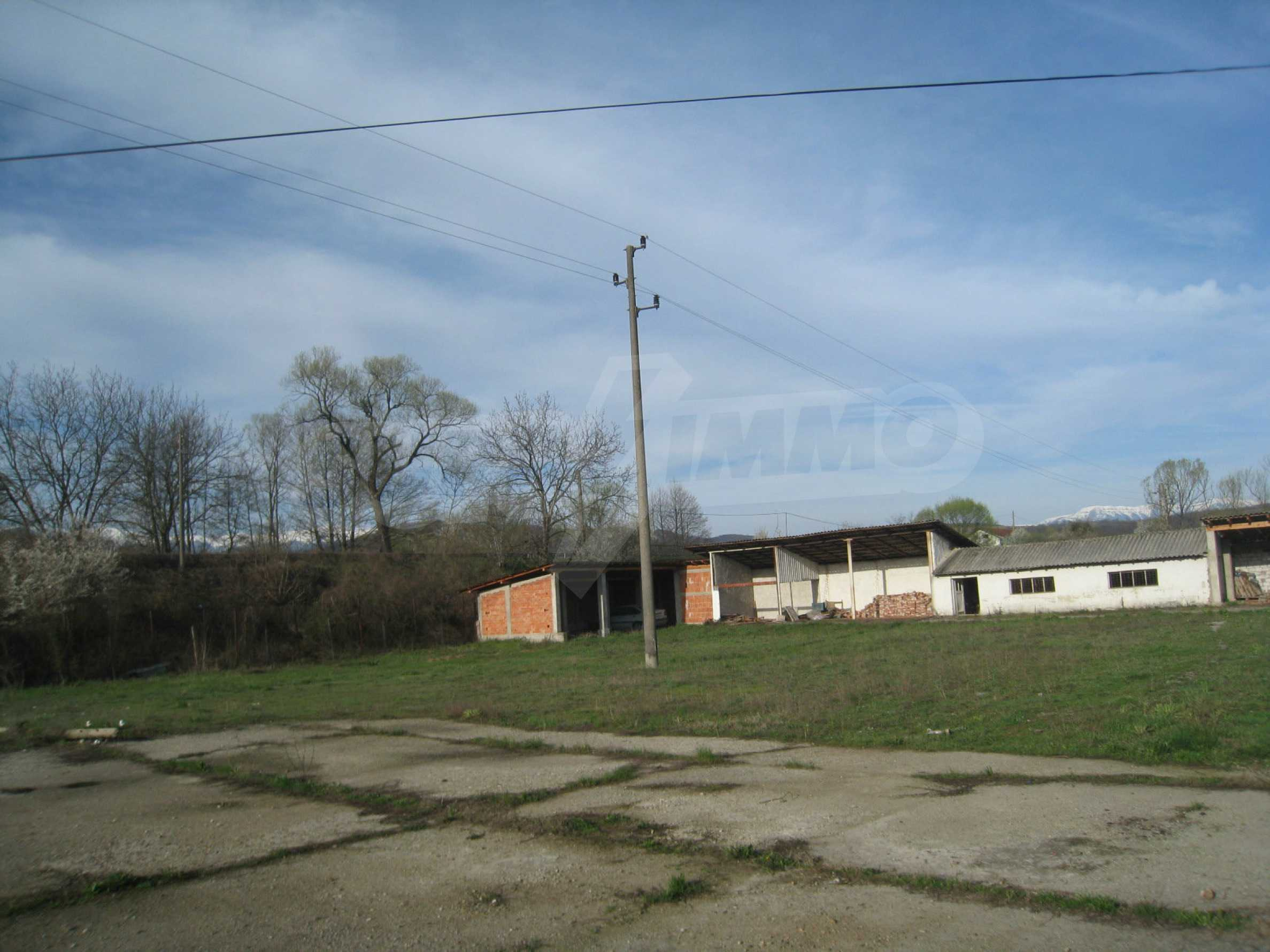 Fishpond, warehouses, residential areas and asphalt ground near Montana 36