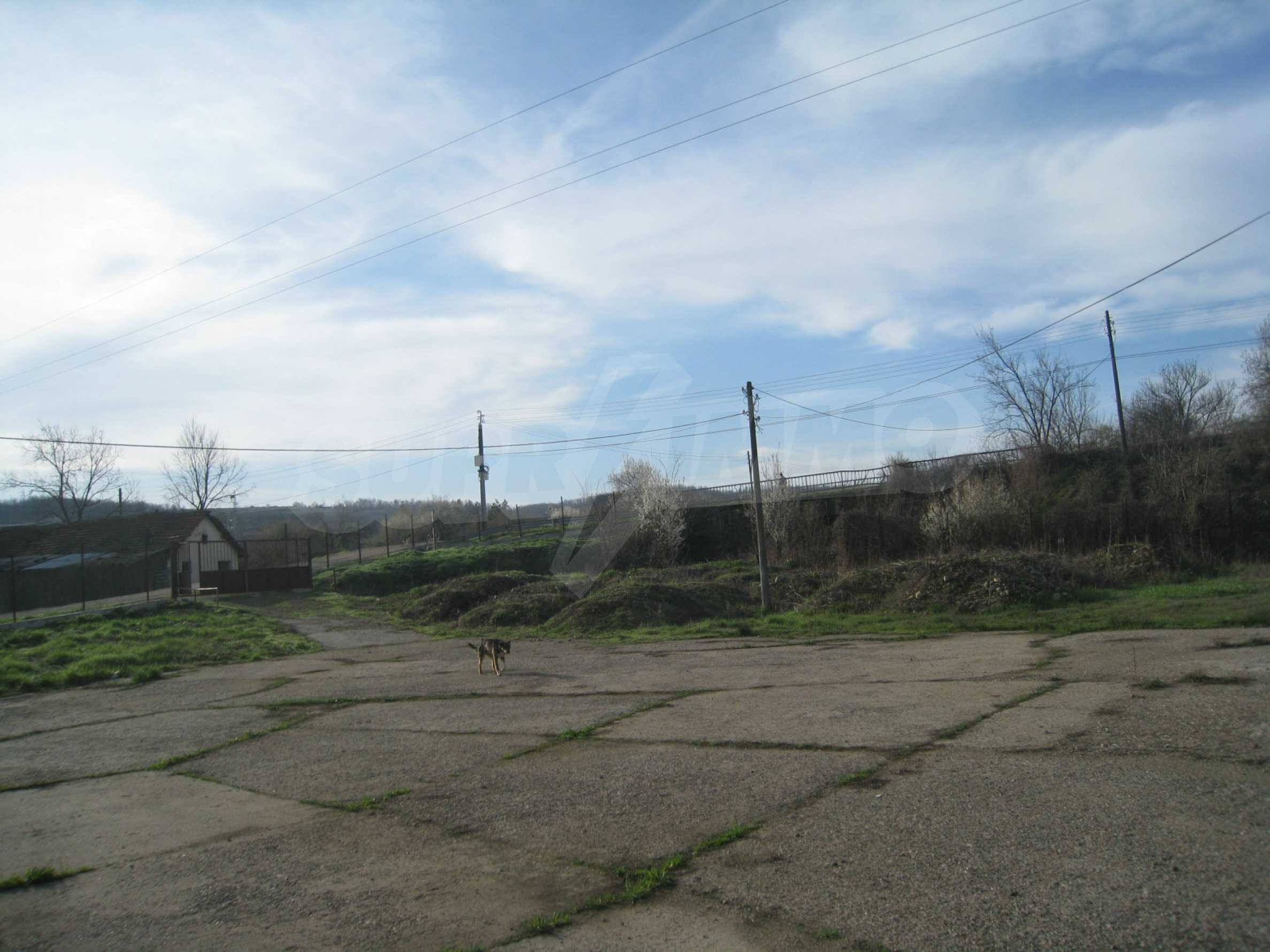 Fishpond, warehouses, residential areas and asphalt ground near Montana 37