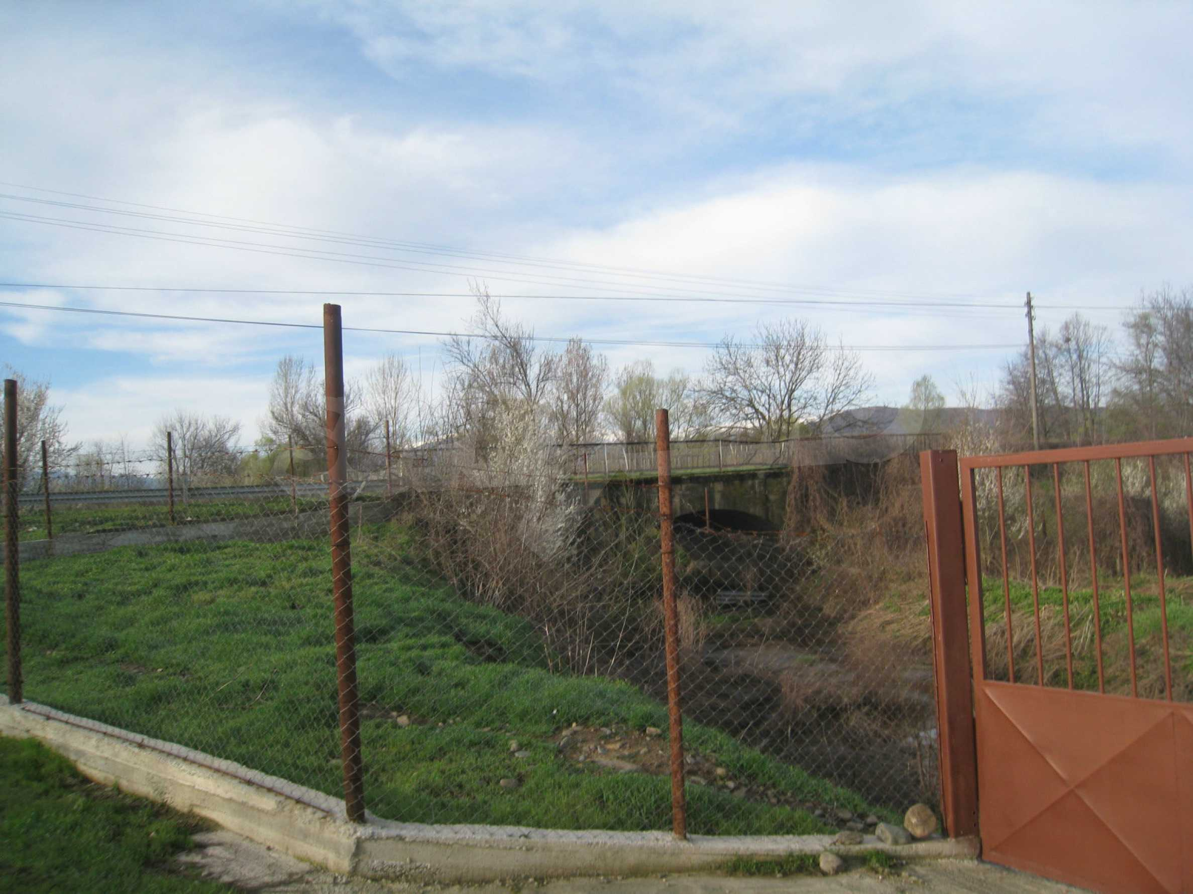 Fishpond, warehouses, residential areas and asphalt ground near Montana 42
