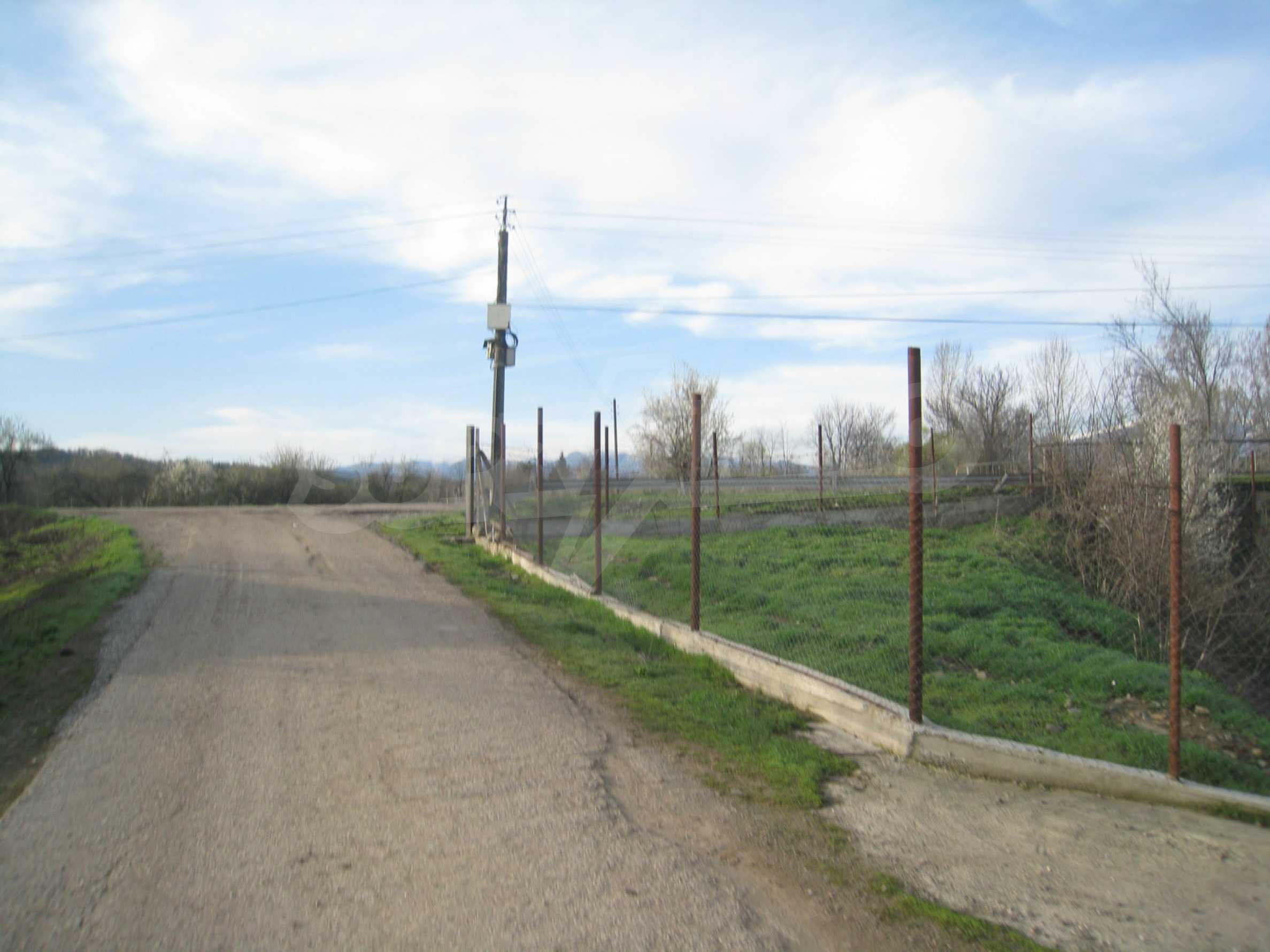 Fishpond, warehouses, residential areas and asphalt ground near Montana 45