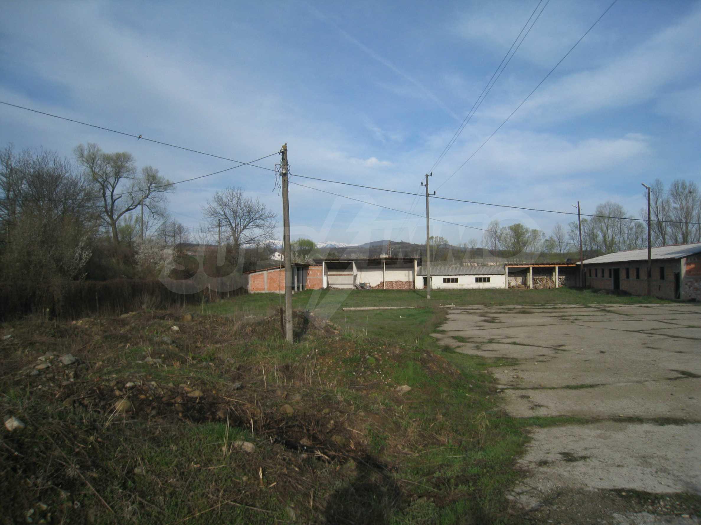 Fishpond, warehouses, residential areas and asphalt ground near Montana 46