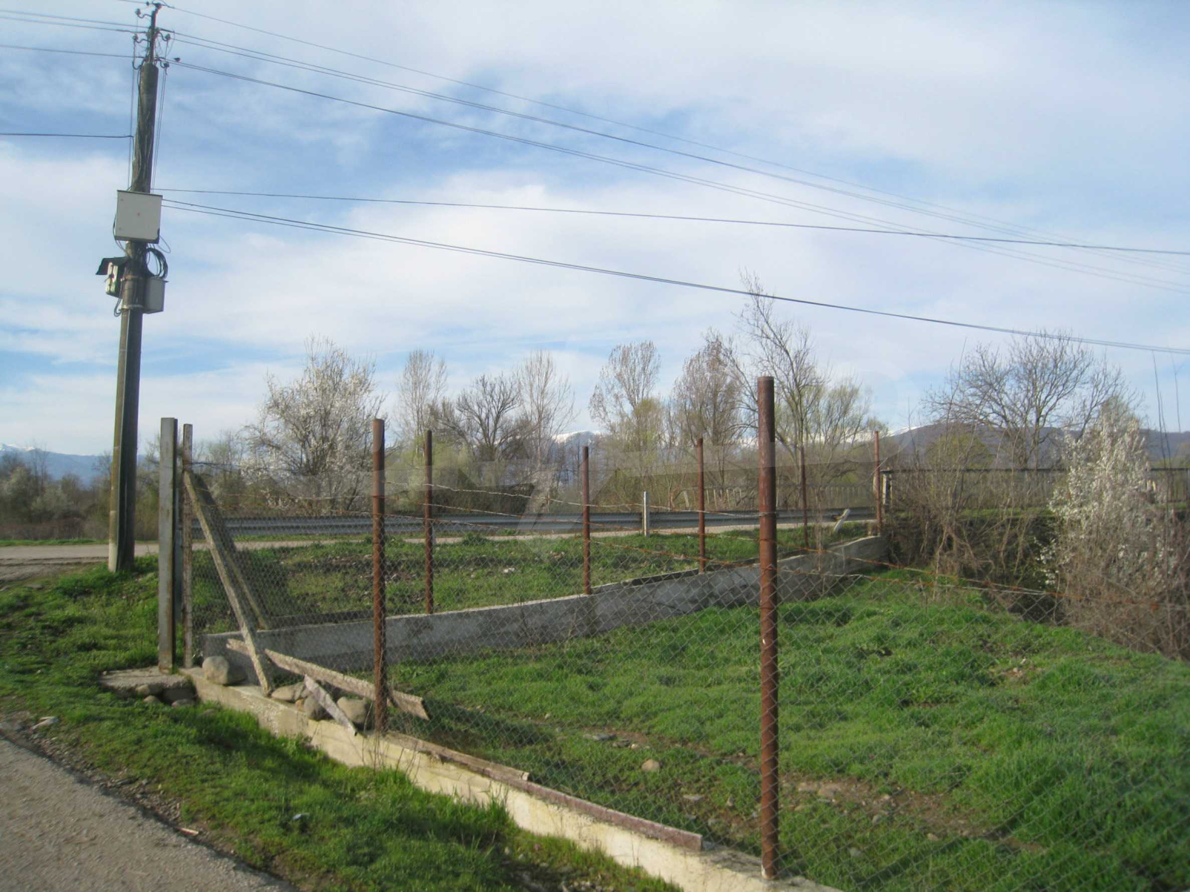 Fishpond, warehouses, residential areas and asphalt ground near Montana 48