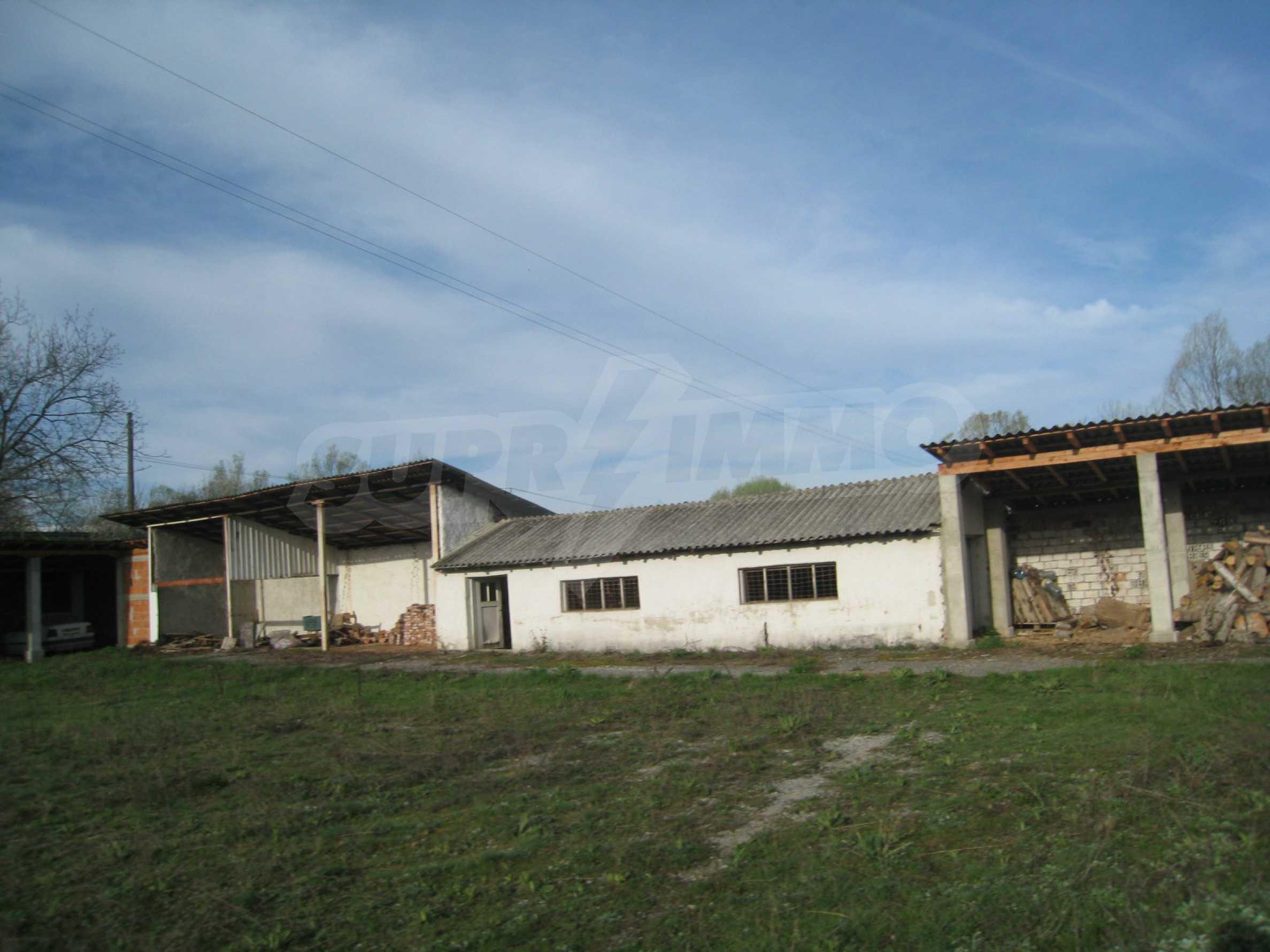 Fishpond, warehouses, residential areas and asphalt ground near Montana 6