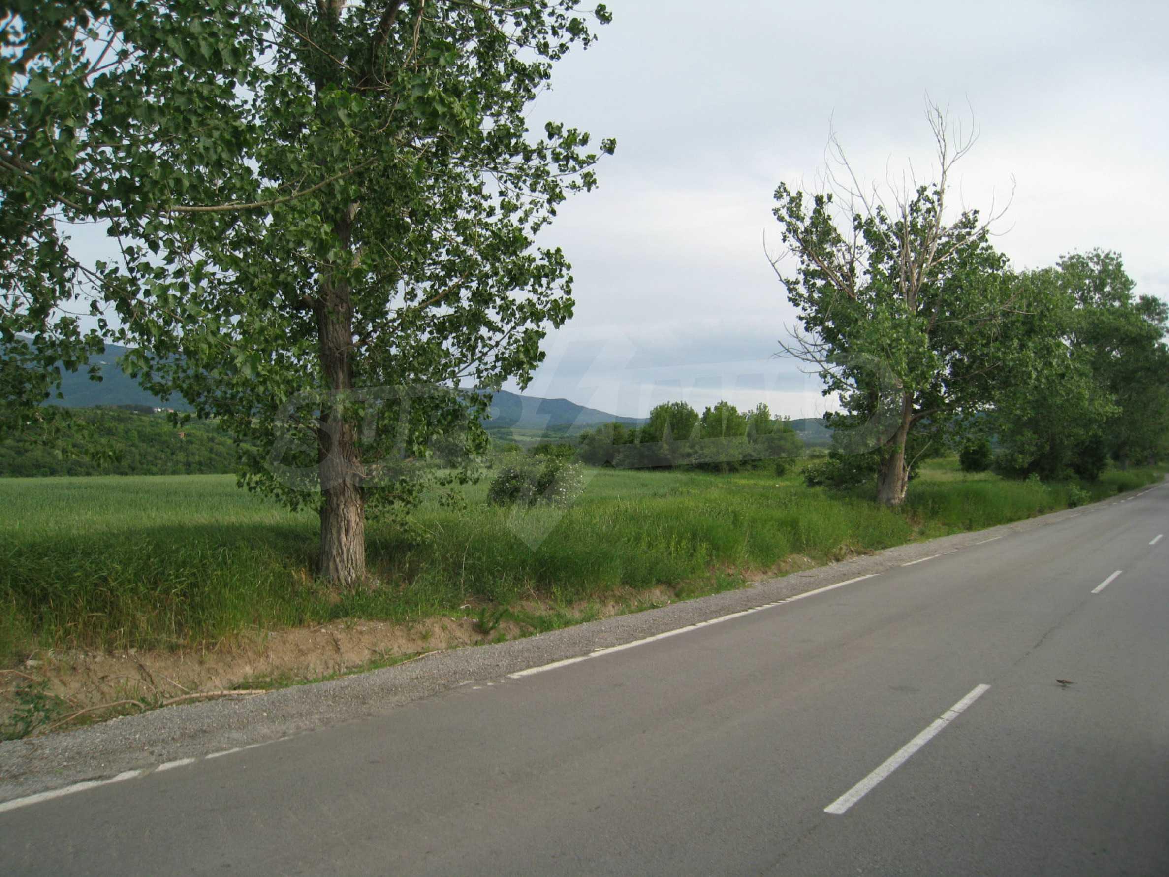 Agricultural land at asphalt road in Suhodol