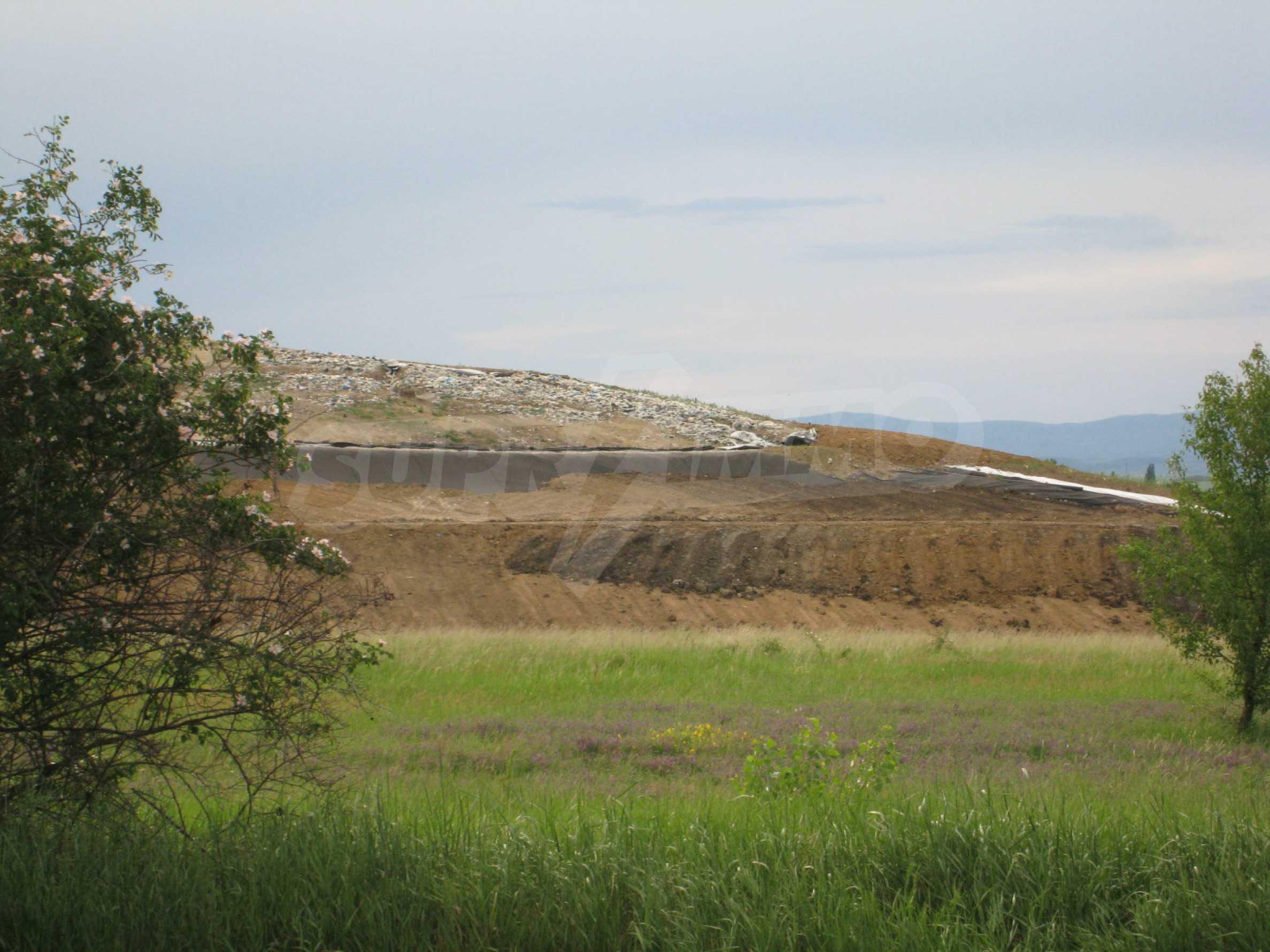 Agricultural land at asphalt road in Suhodol 15