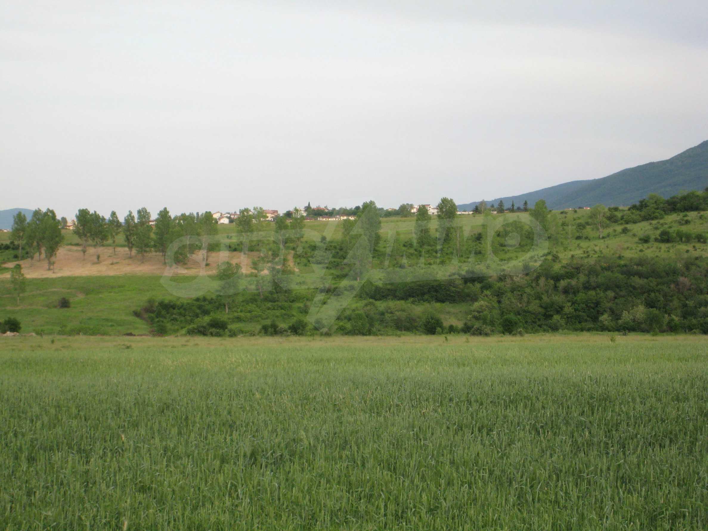 Agricultural land at asphalt road in Suhodol 8