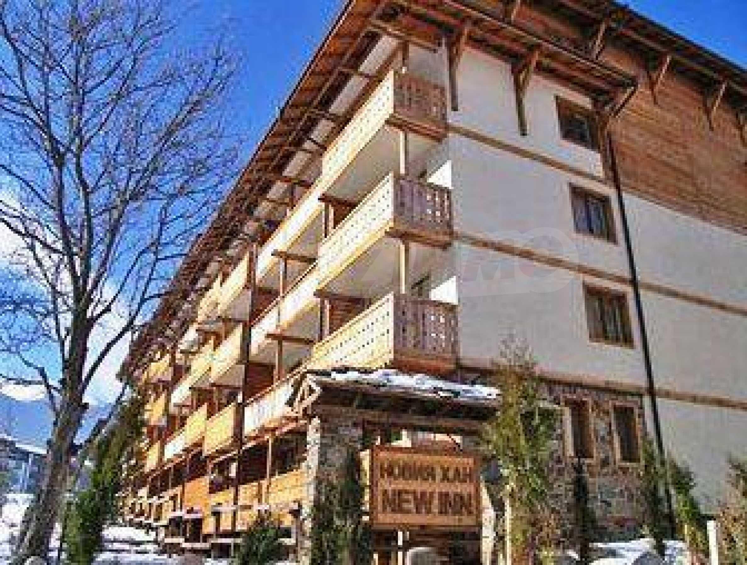 Тристаен апартамент с камина в Банско
