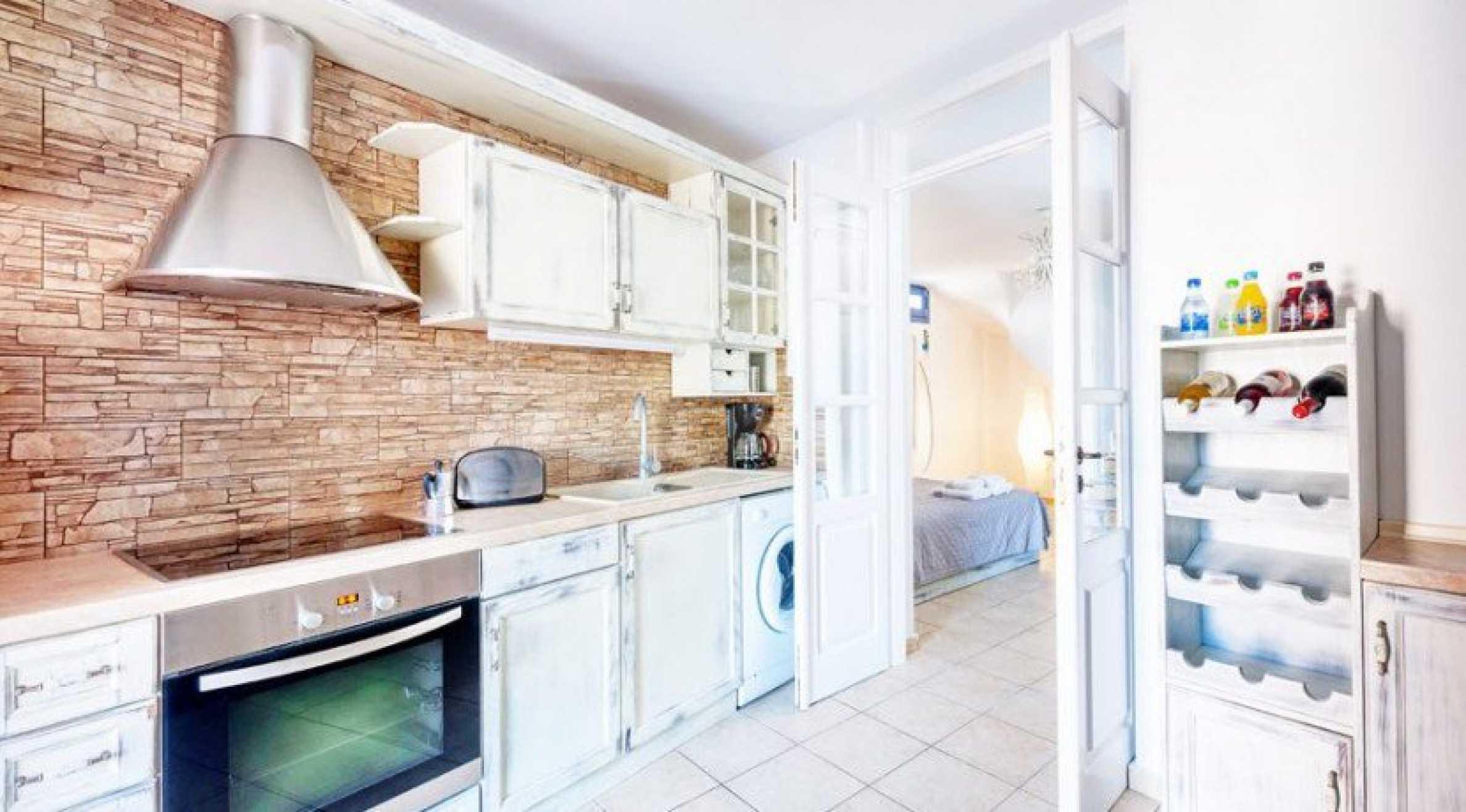 Първокласен имот до Белия плаж на остров Санторини 4
