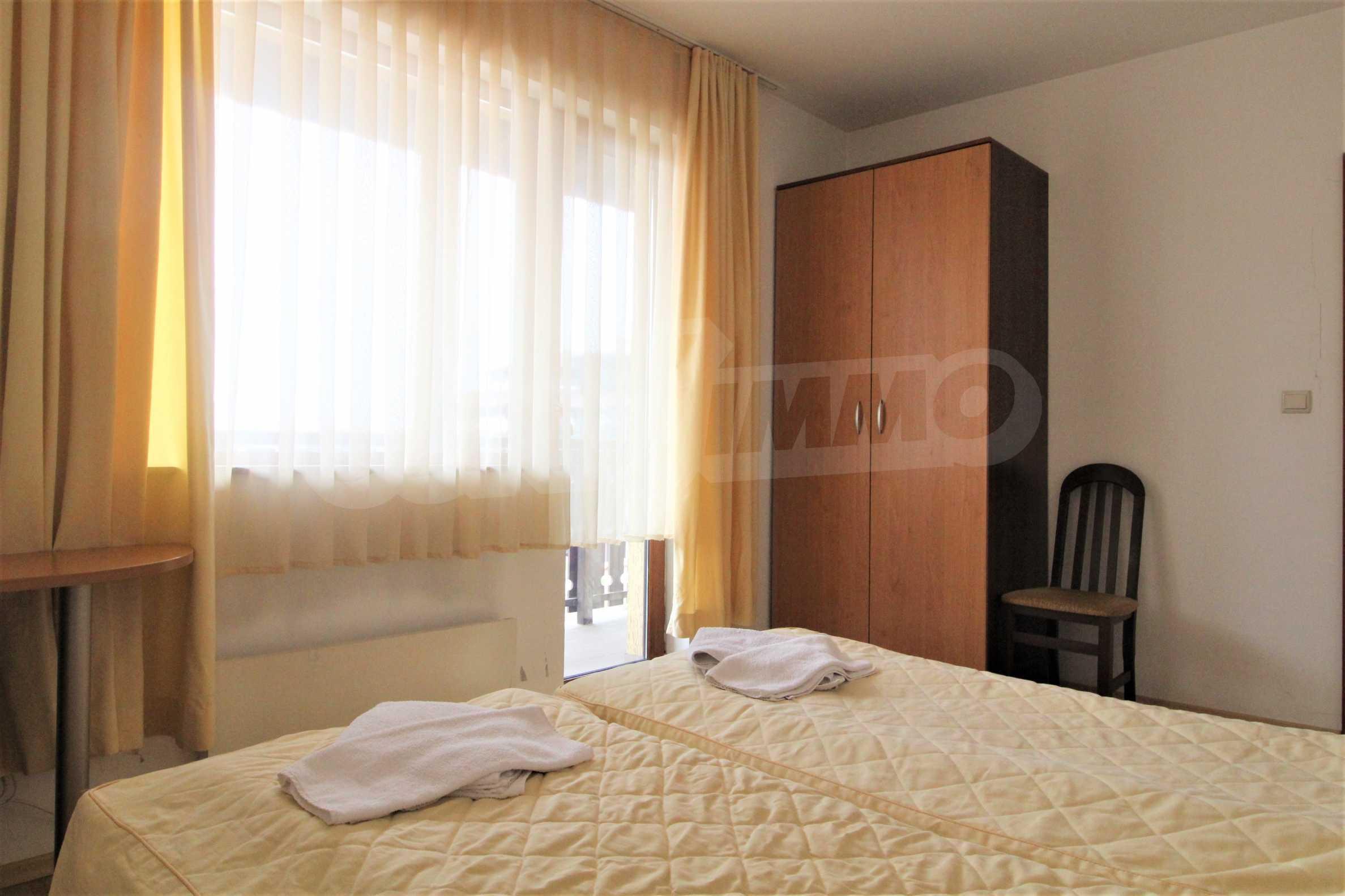 Уютен тристаен апартамент, разположен в комплекс Топ Лодж, само на метри от ски лифта в Банско 8