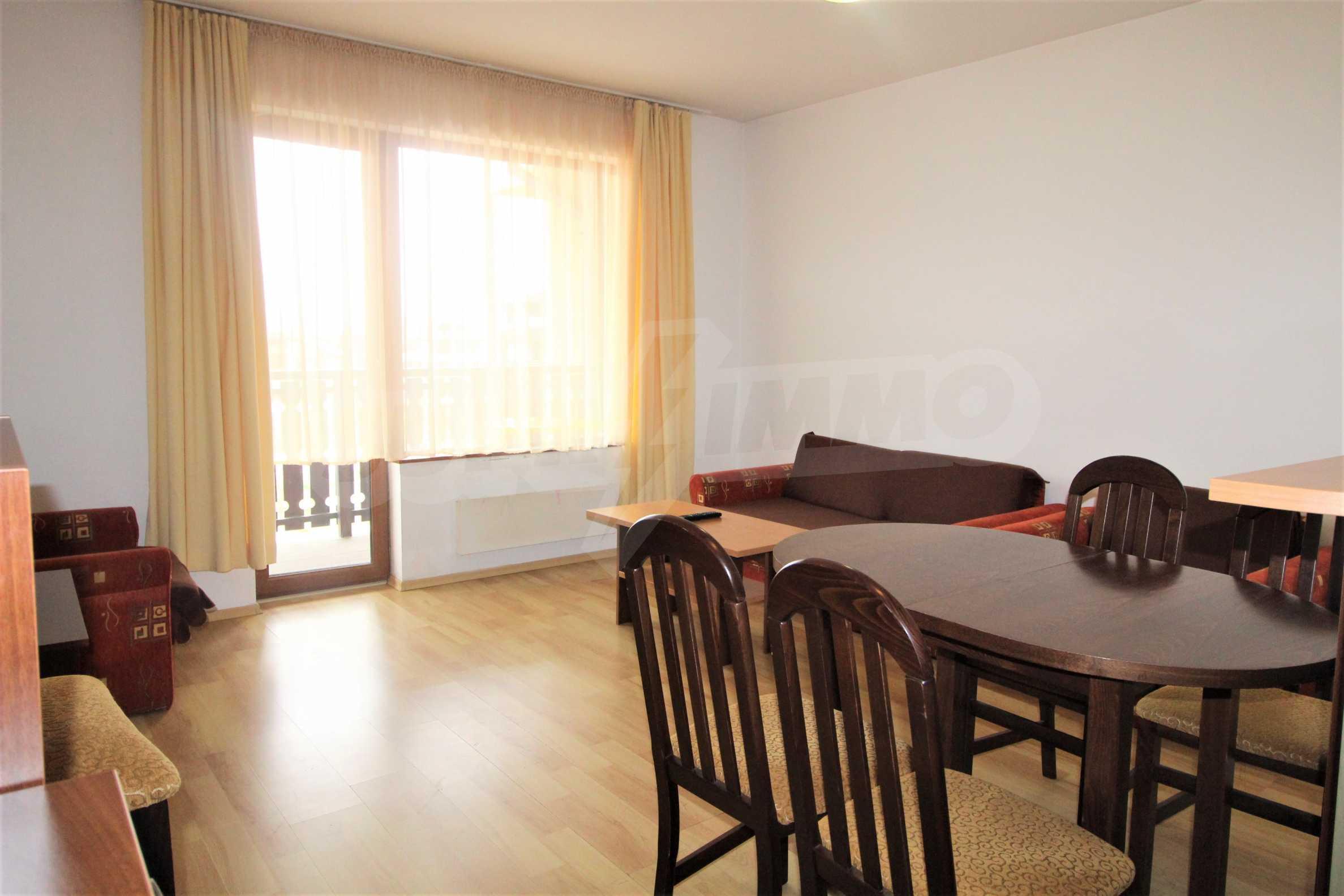Уютен тристаен апартамент, разположен в комплекс Топ Лодж, само на метри от ски лифта в Банско 2
