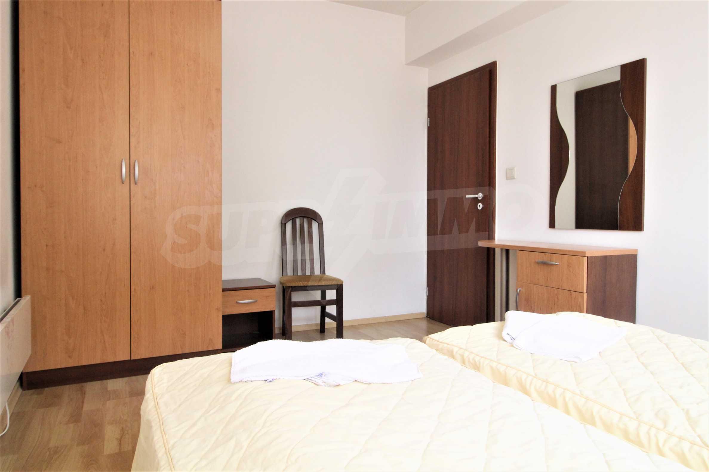Уютен тристаен апартамент, разположен в комплекс Топ Лодж, само на метри от ски лифта в Банско 4