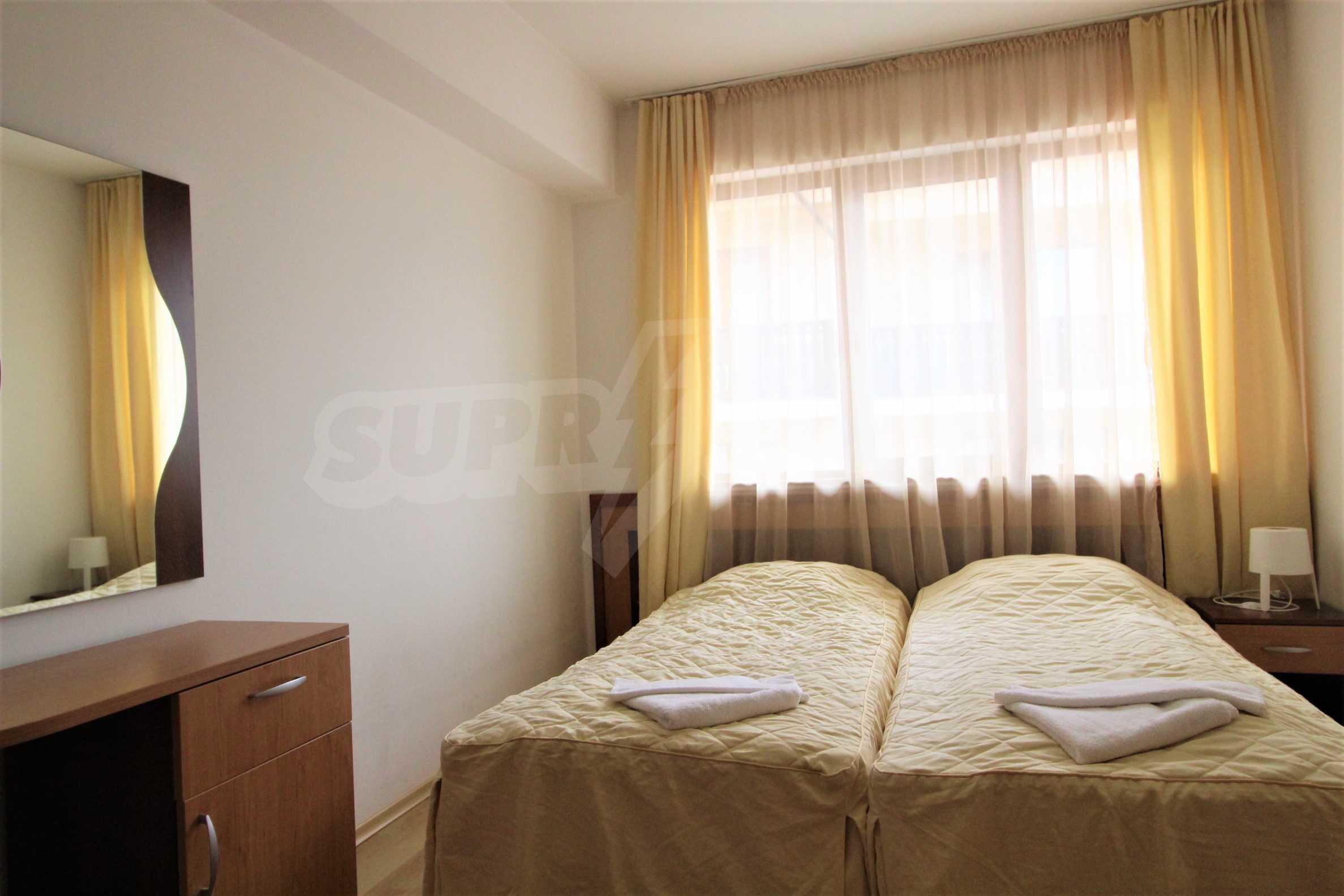 Уютен тристаен апартамент, разположен в комплекс Топ Лодж, само на метри от ски лифта в Банско 5