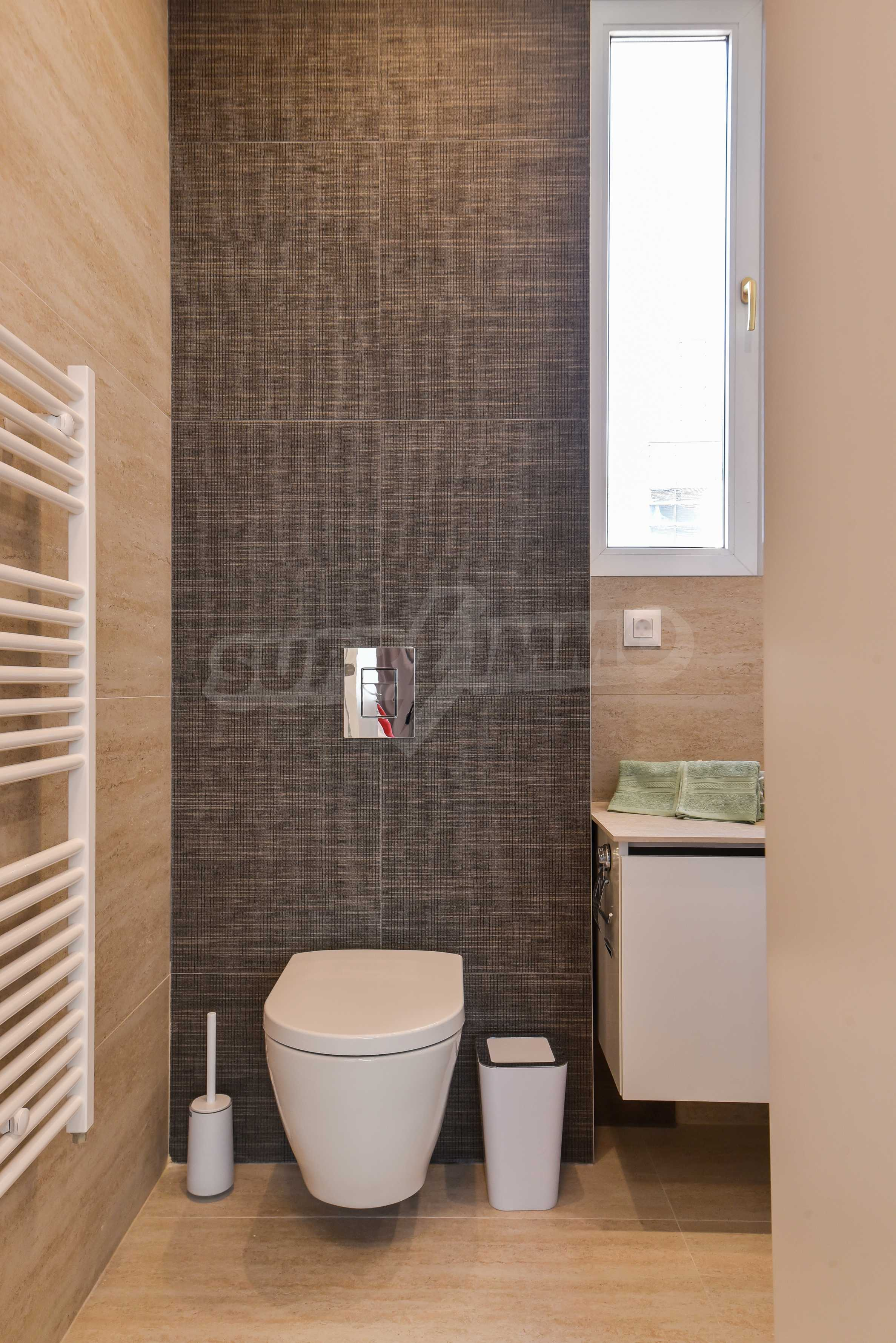 Modern three bedroom apartment with working business in the center of Sofia 23