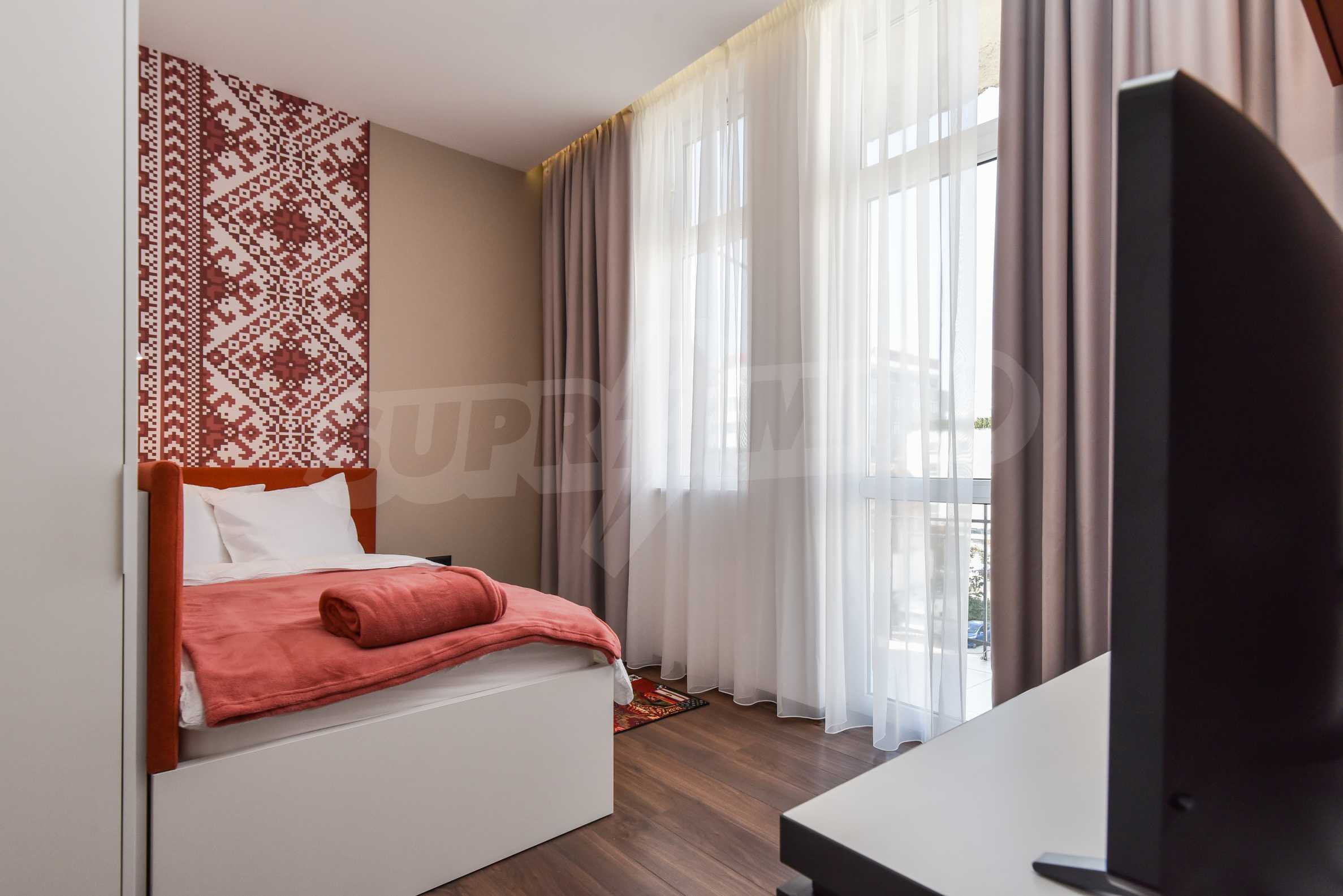 Modern three bedroom apartment with working business in the center of Sofia 25