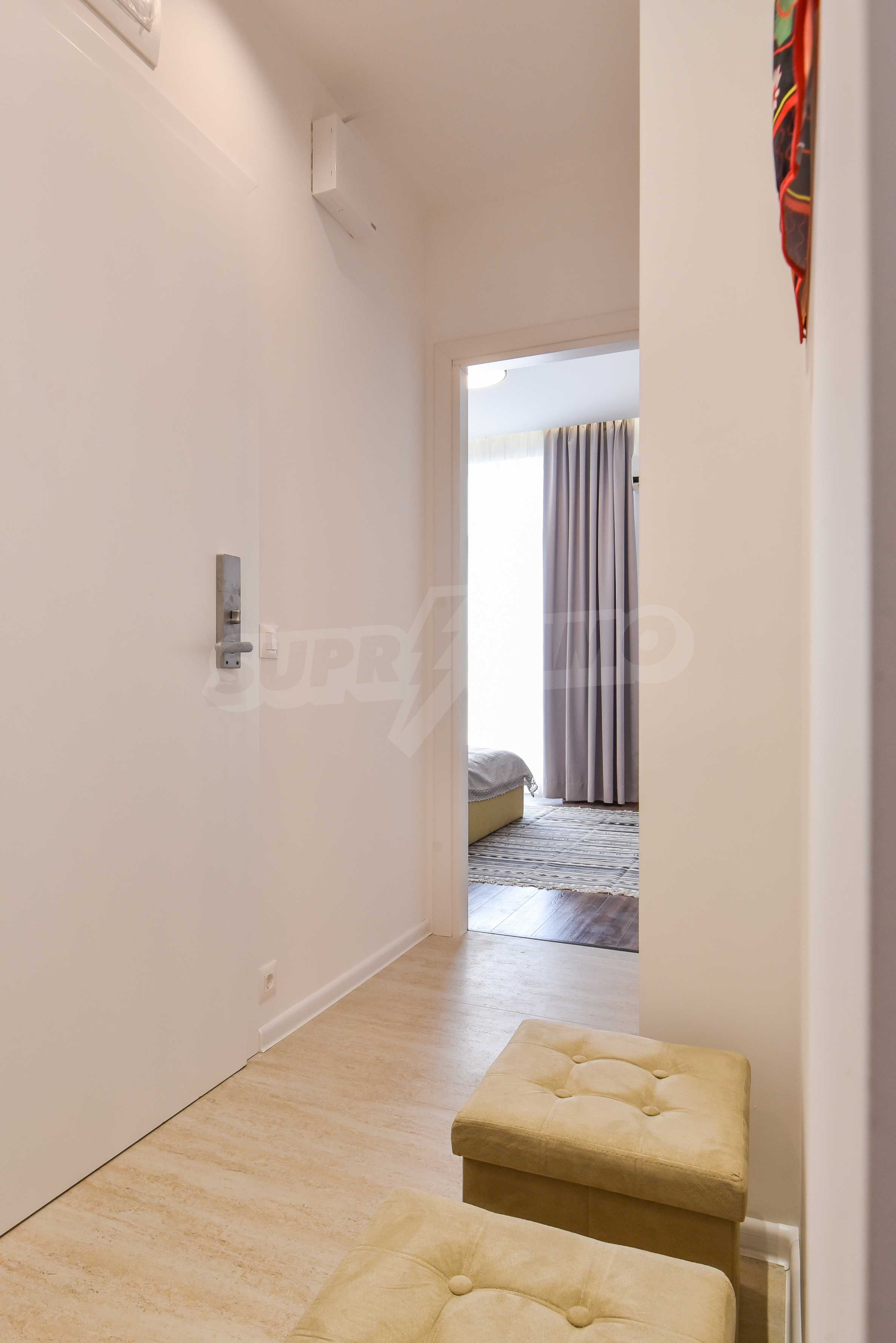 Modern three bedroom apartment with working business in the center of Sofia 33