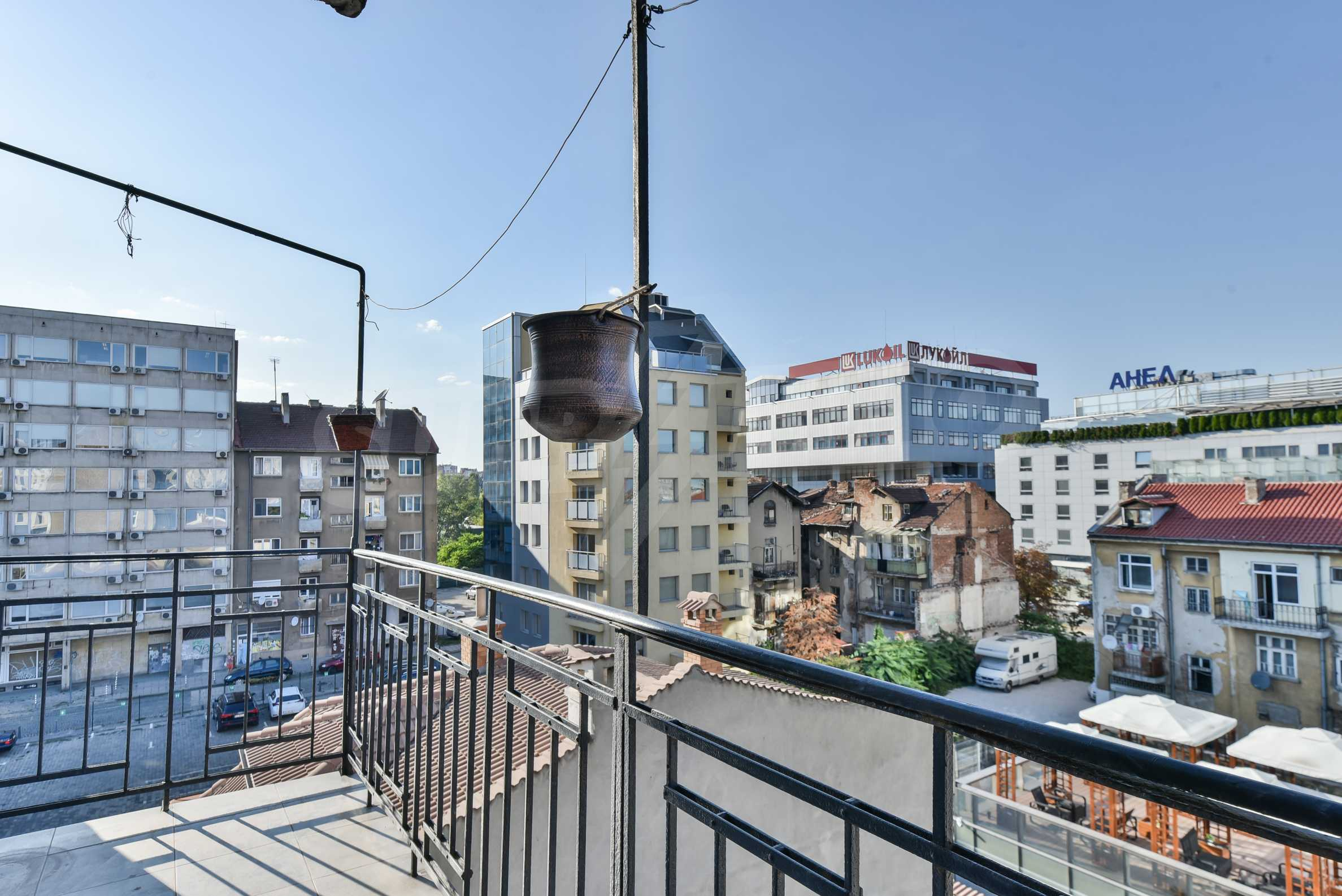 Modern three bedroom apartment with working business in the center of Sofia 35