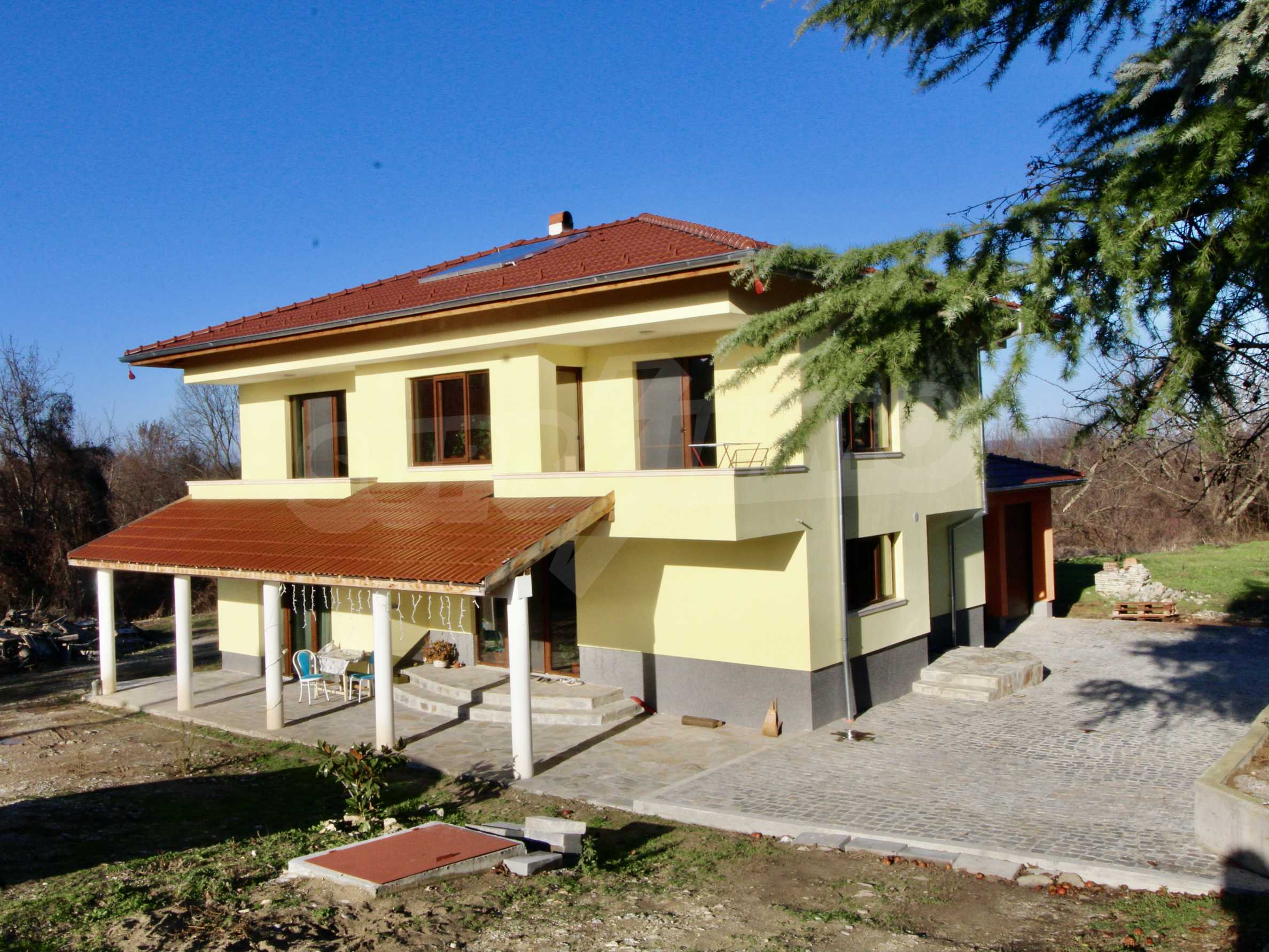 Newly built two-storey house with two garages in Dragizhevo village