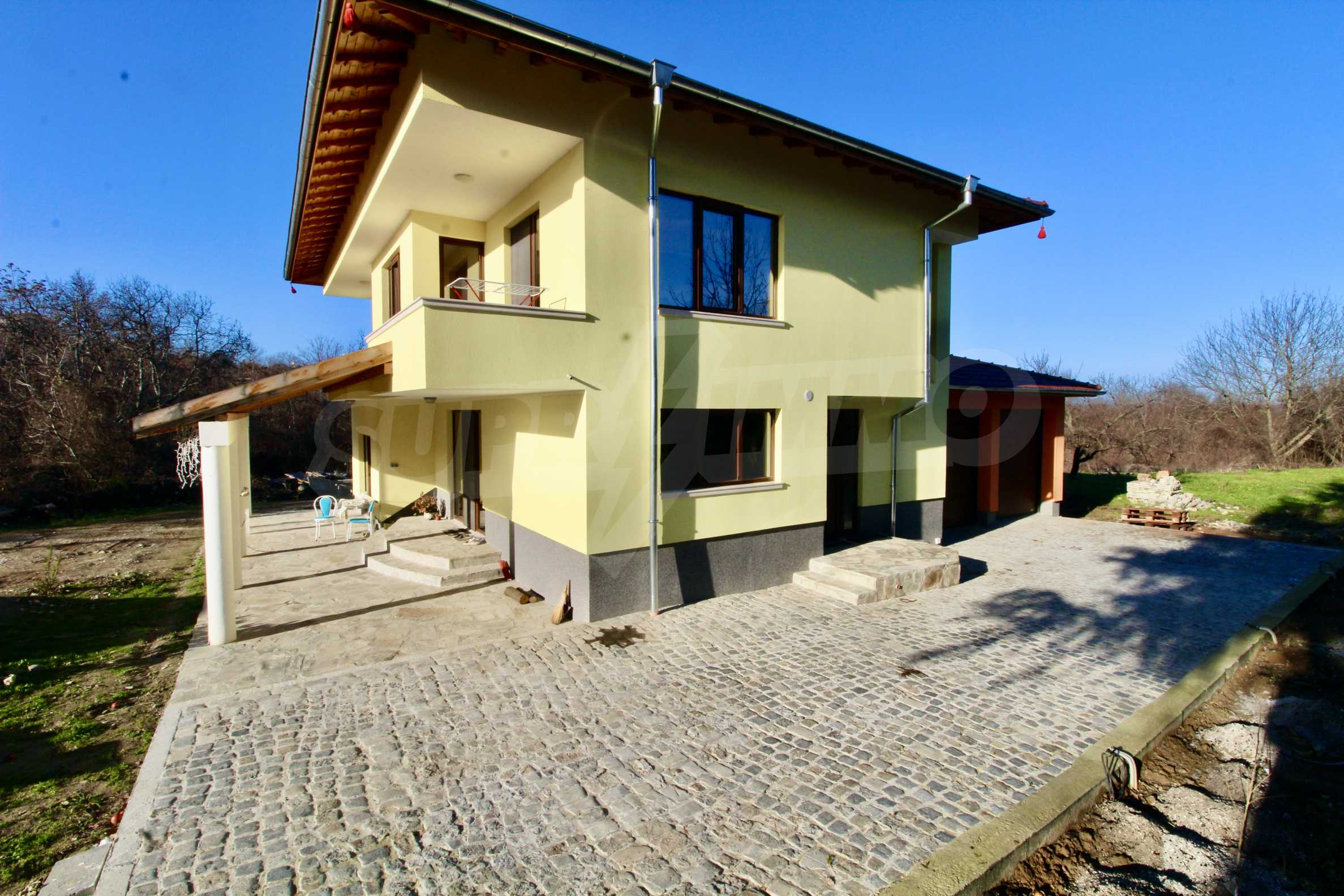 Newly built two-storey house with two garages in Dragizhevo village 4