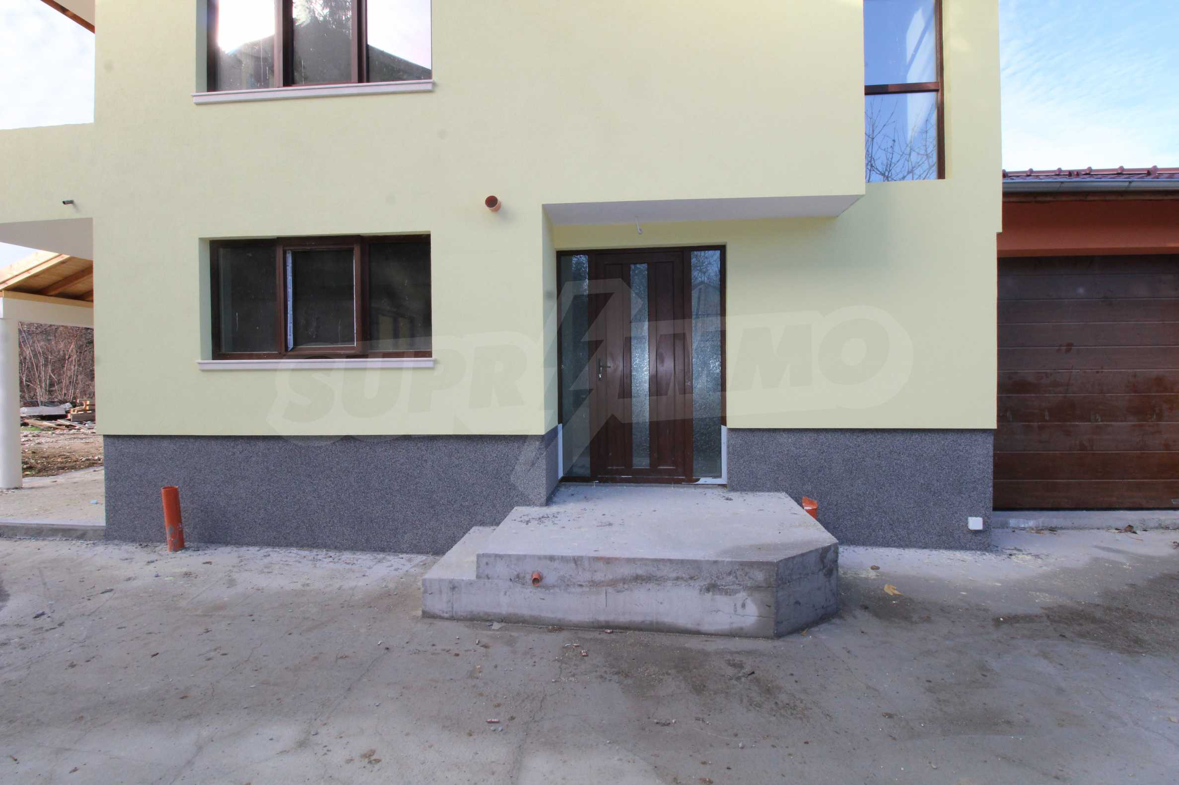Newly built two-storey house with two garages in Dragizhevo village 65