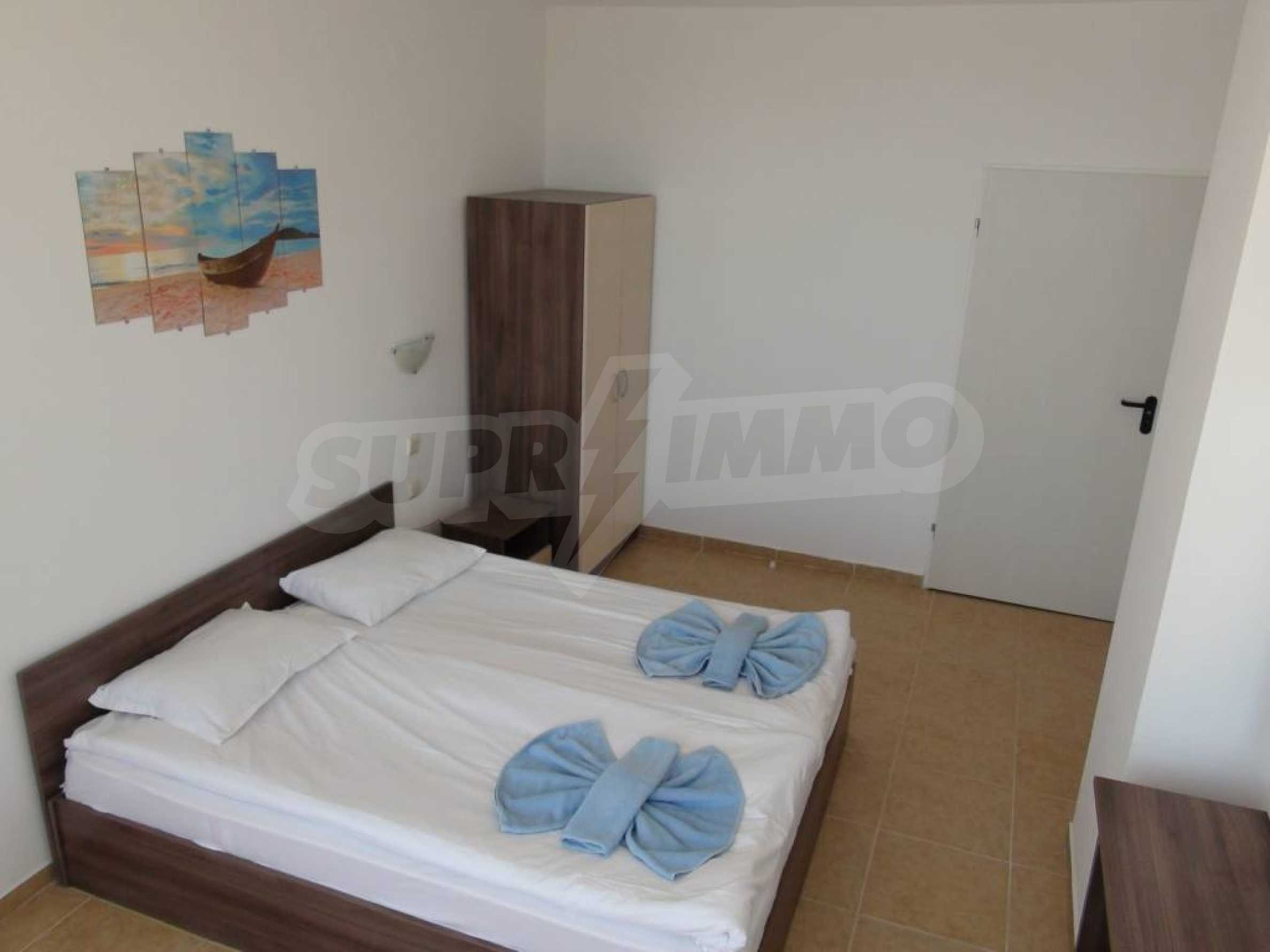 Two-bedroom apartment in a complex on the first line 26